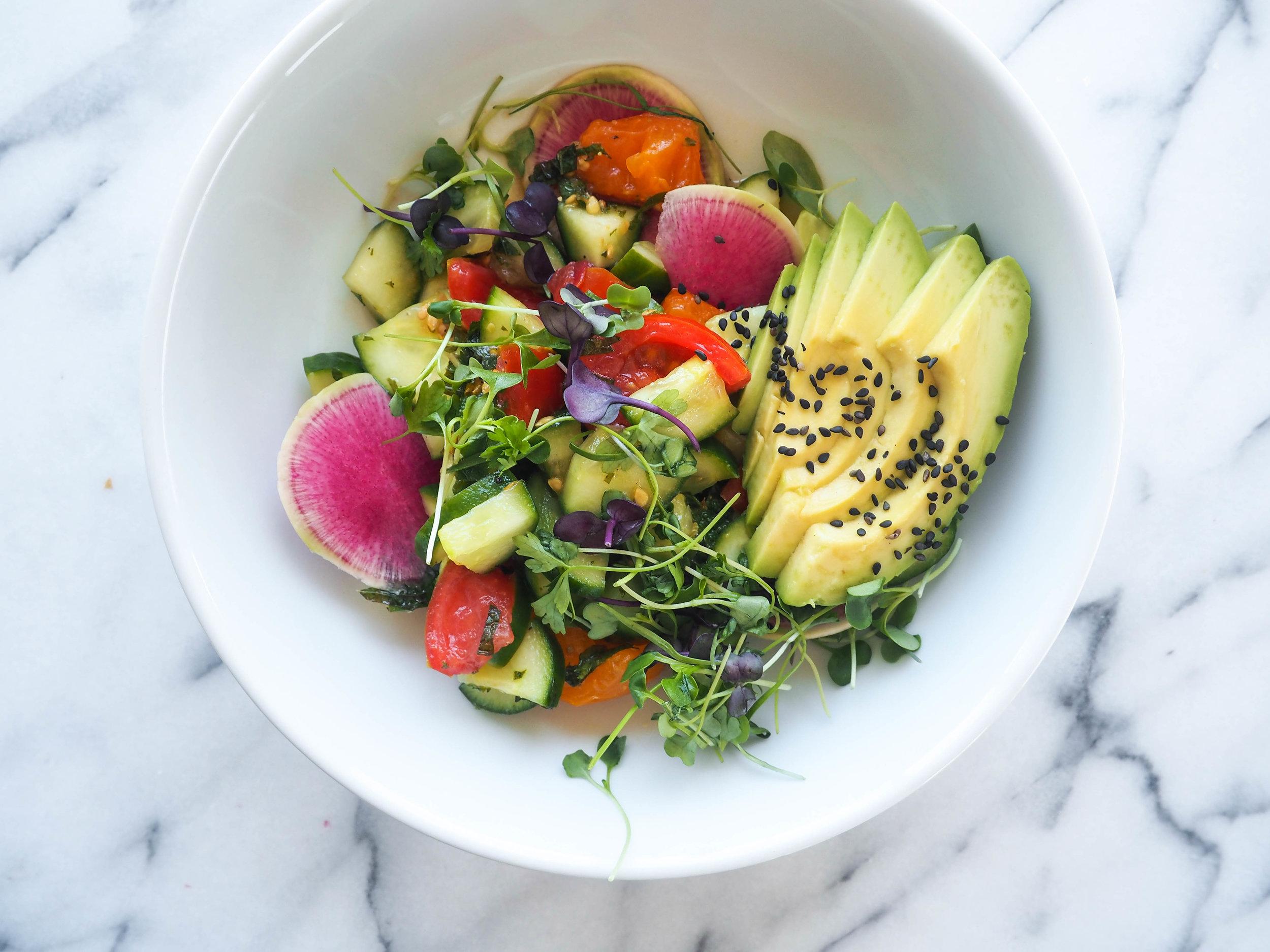 cucumber tomato mont salad with microgreens