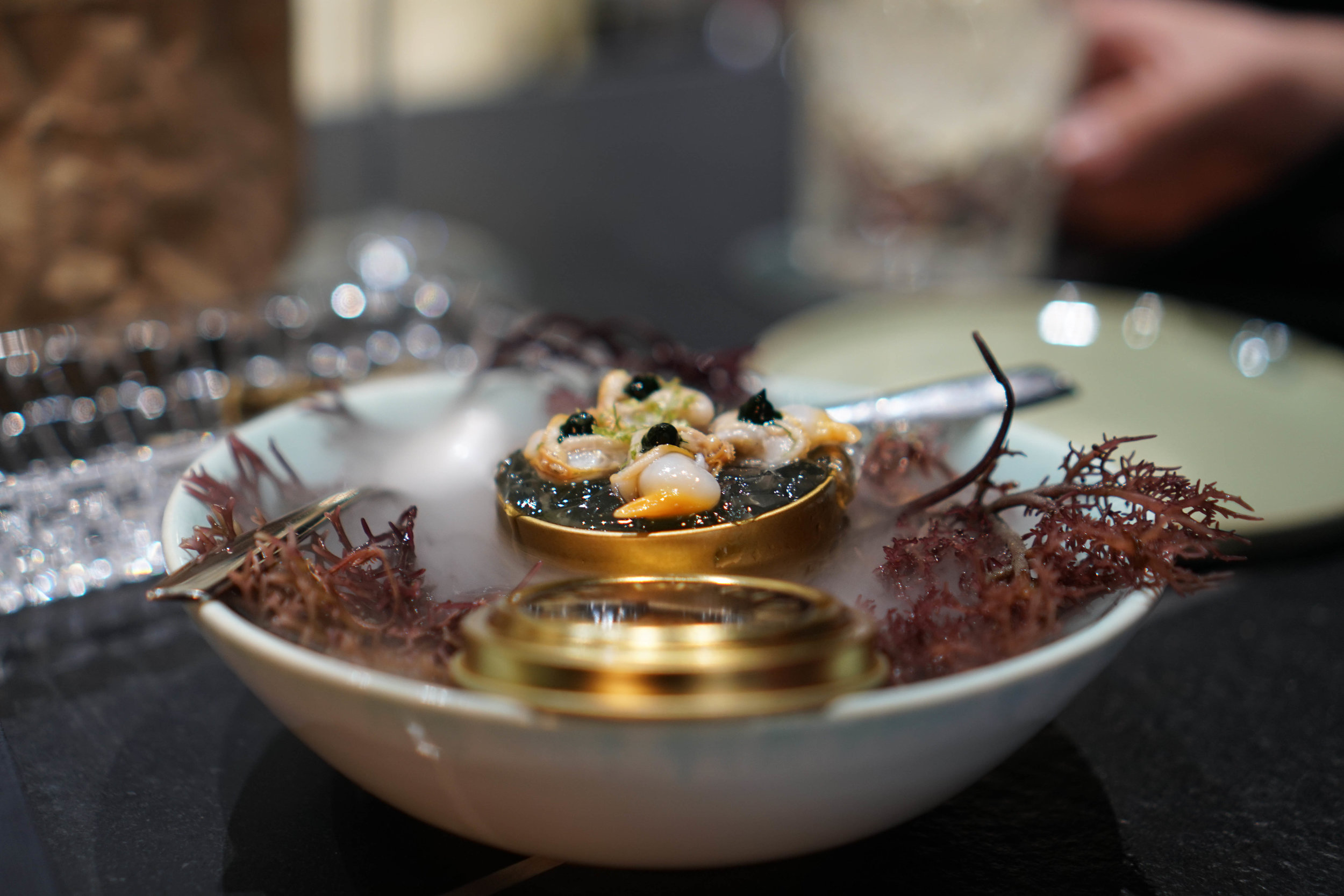 Wonder what the sea taste like? This lovely presentation of a marine bite of cockles, algae, and plankton in all presented in a tin of caviar is just that.