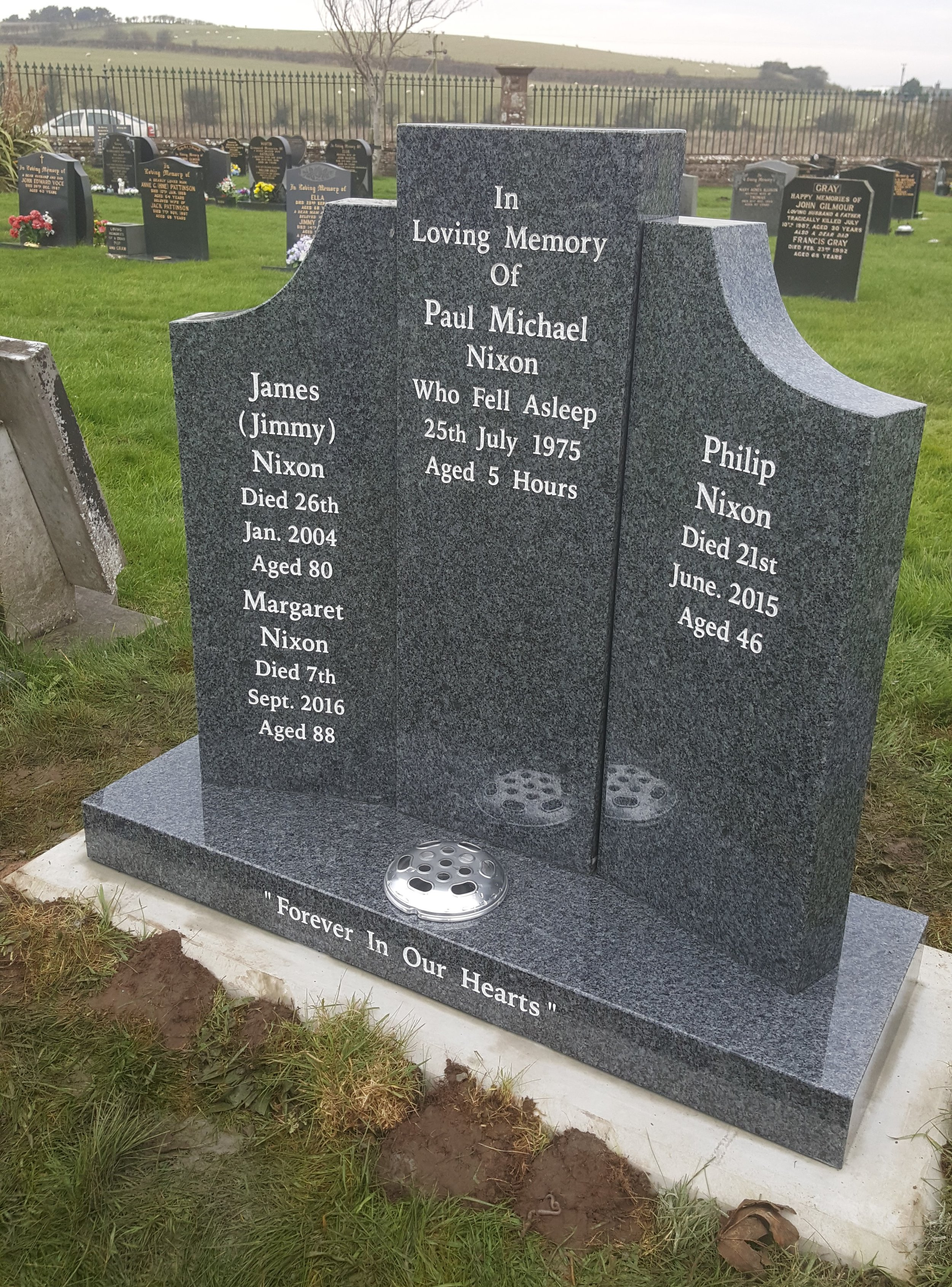 Winged grey memorial