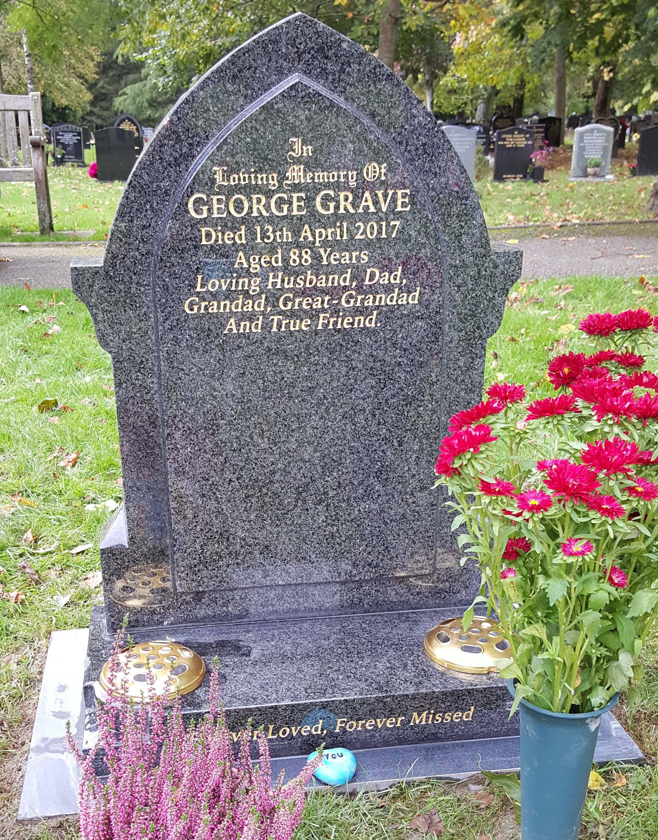 Grey granite gothic shaped headstone