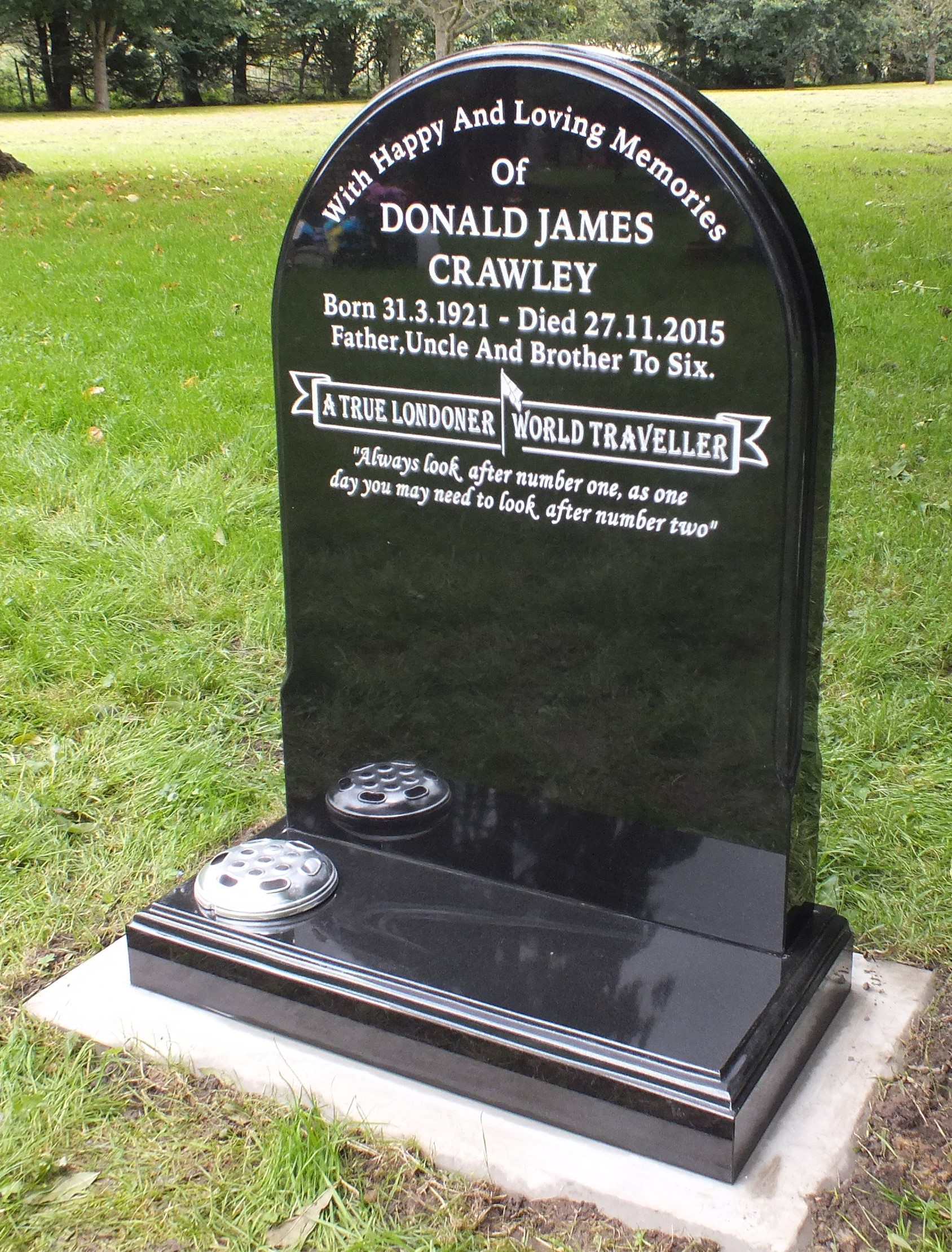 Norman shaped black granite memorial with banner design