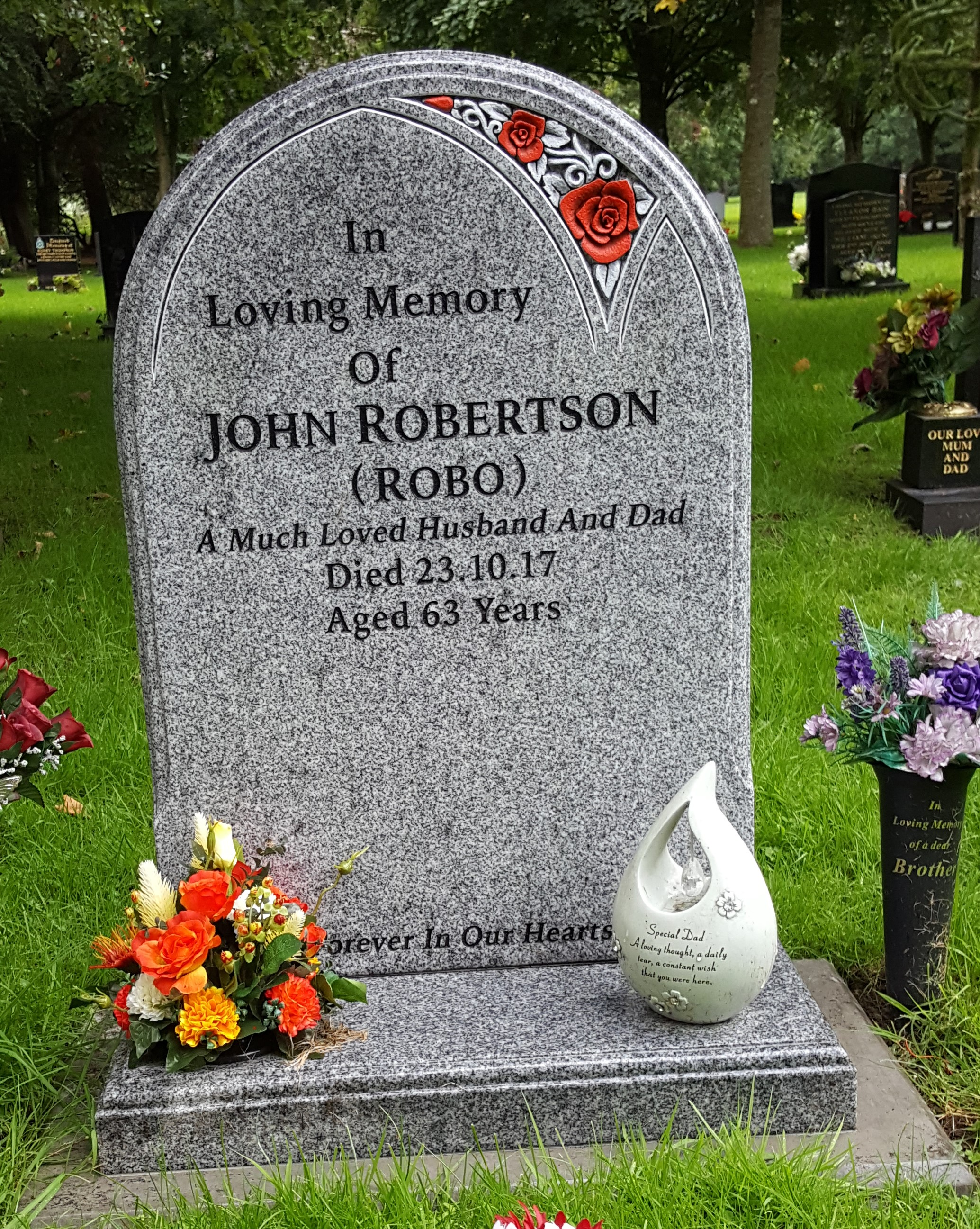 Red rose design with Norman shaped memorial