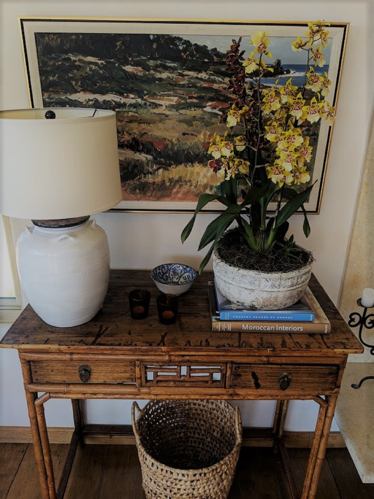 chinese_antique_console_with_yellow_and_orange_orchids_staged_living_room_hart_habitats.jpg