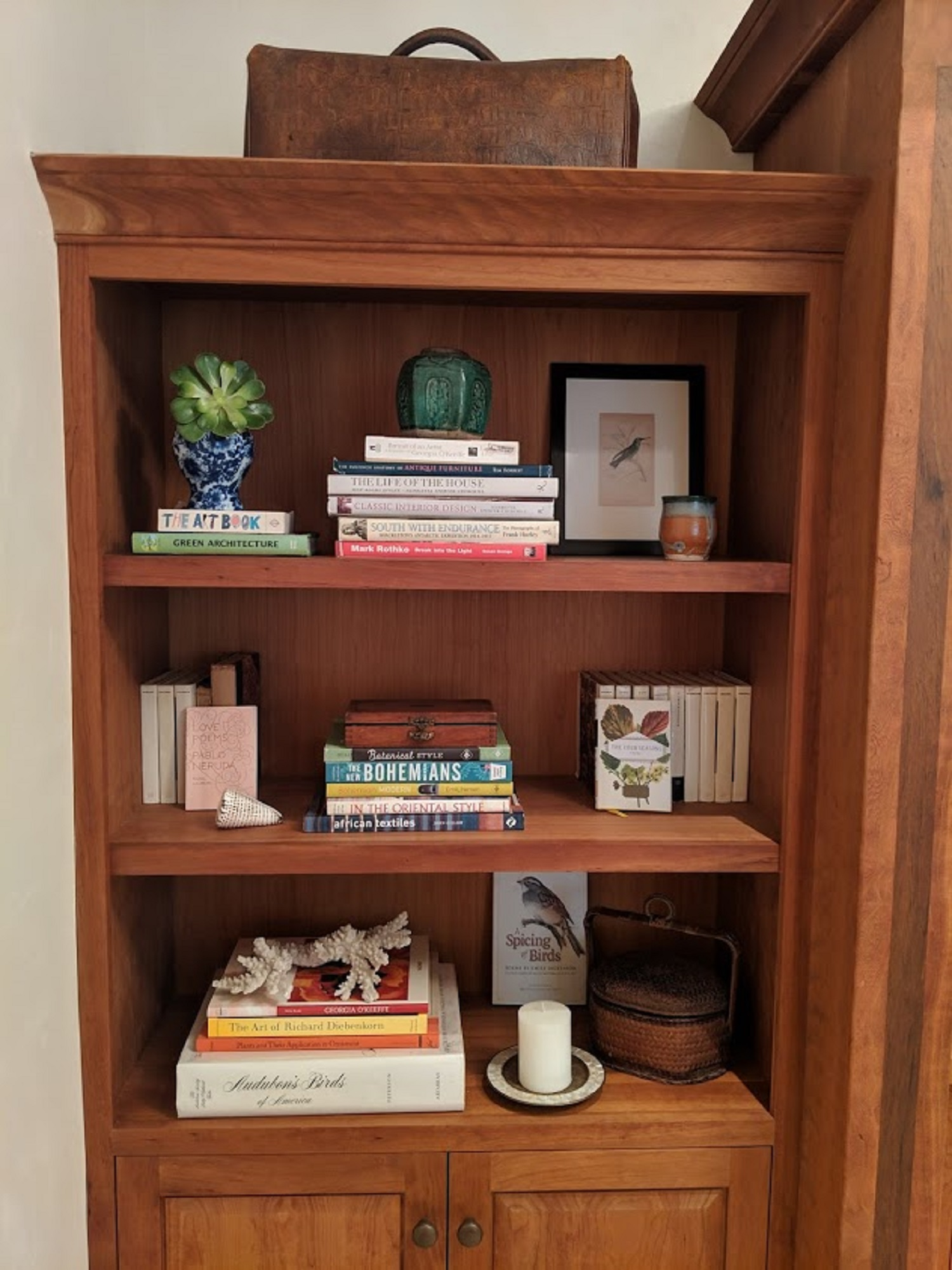 Hart Habitats often incorporates clipped succulents, from their garden, into their styled shelving. They last forever and add an organic feel and a pretty pop of green to bookcases.