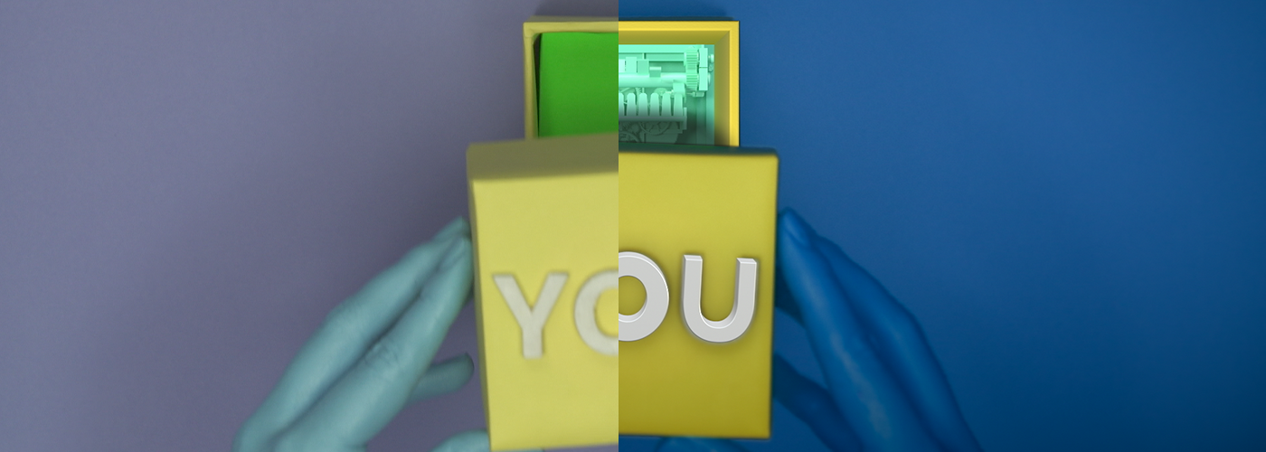 """Colors of hands and background were simply edited in DaVinci Resolve. Box itself required more attention - letters """"YOU"""", originally made out of wood, were not bright enough, so we replaced them with 3D ones. Box underneath was masked out and replaced with a perfectly-shaped 3D one as well."""