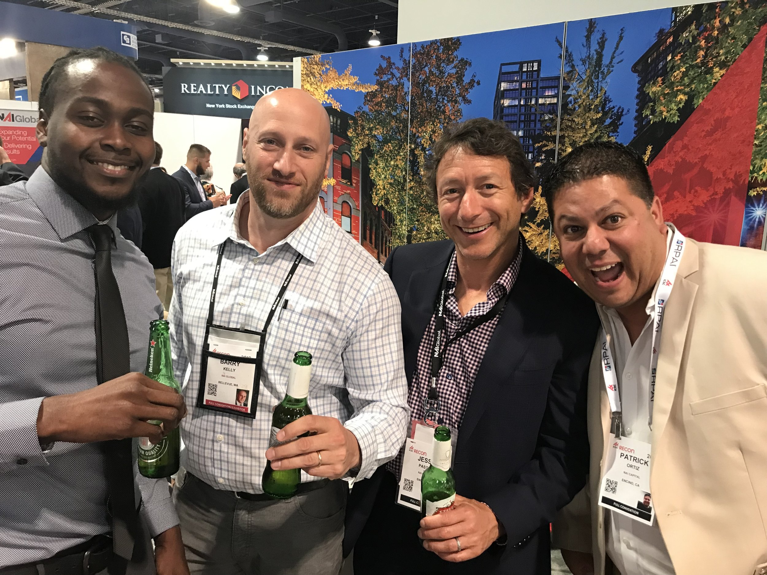 Vice President Jesse Paster (second from right) smiles with other NAI brokers at ICSC RECon in Las Vegas.