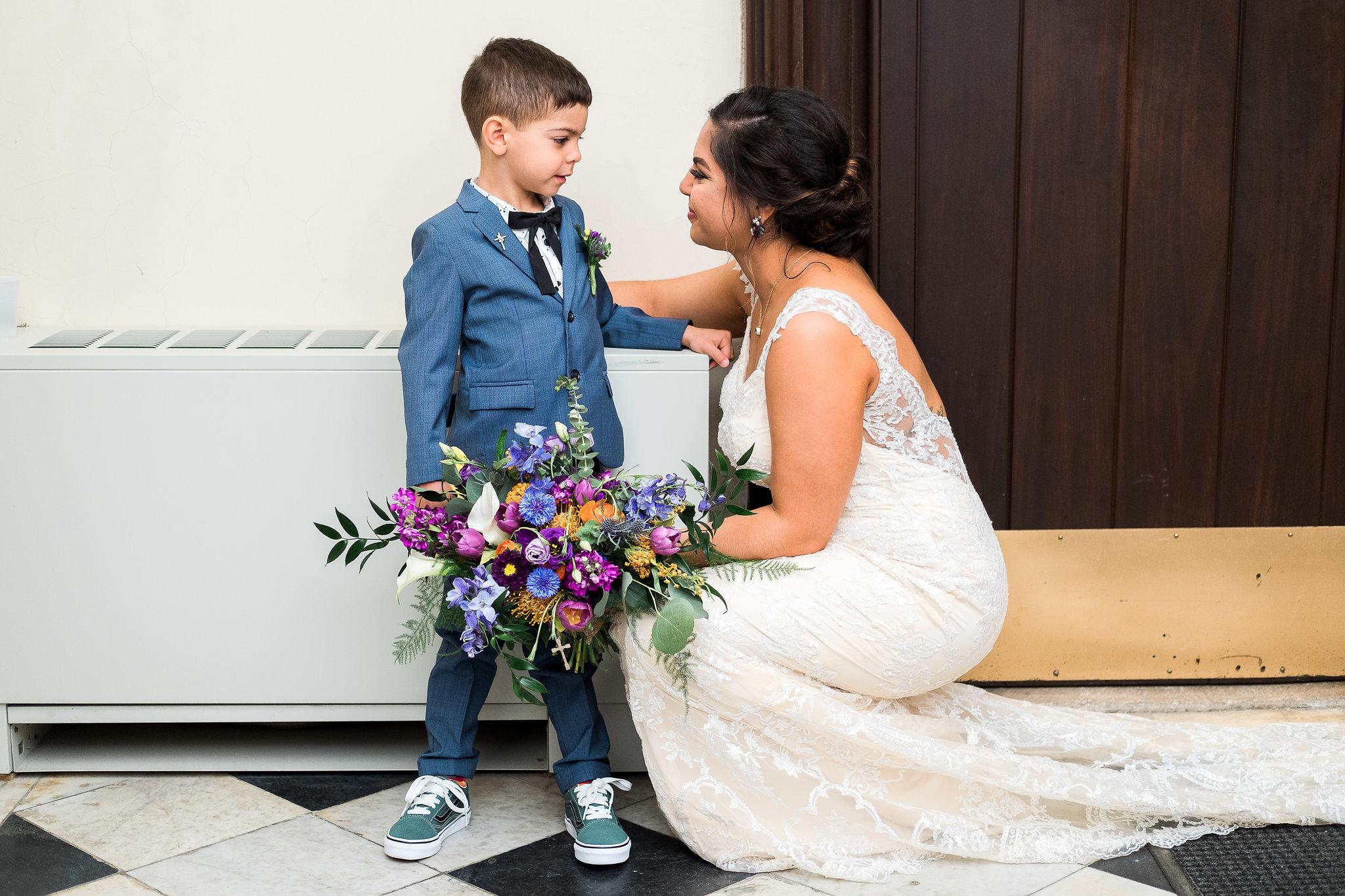 Bride with son before wedding ceremony