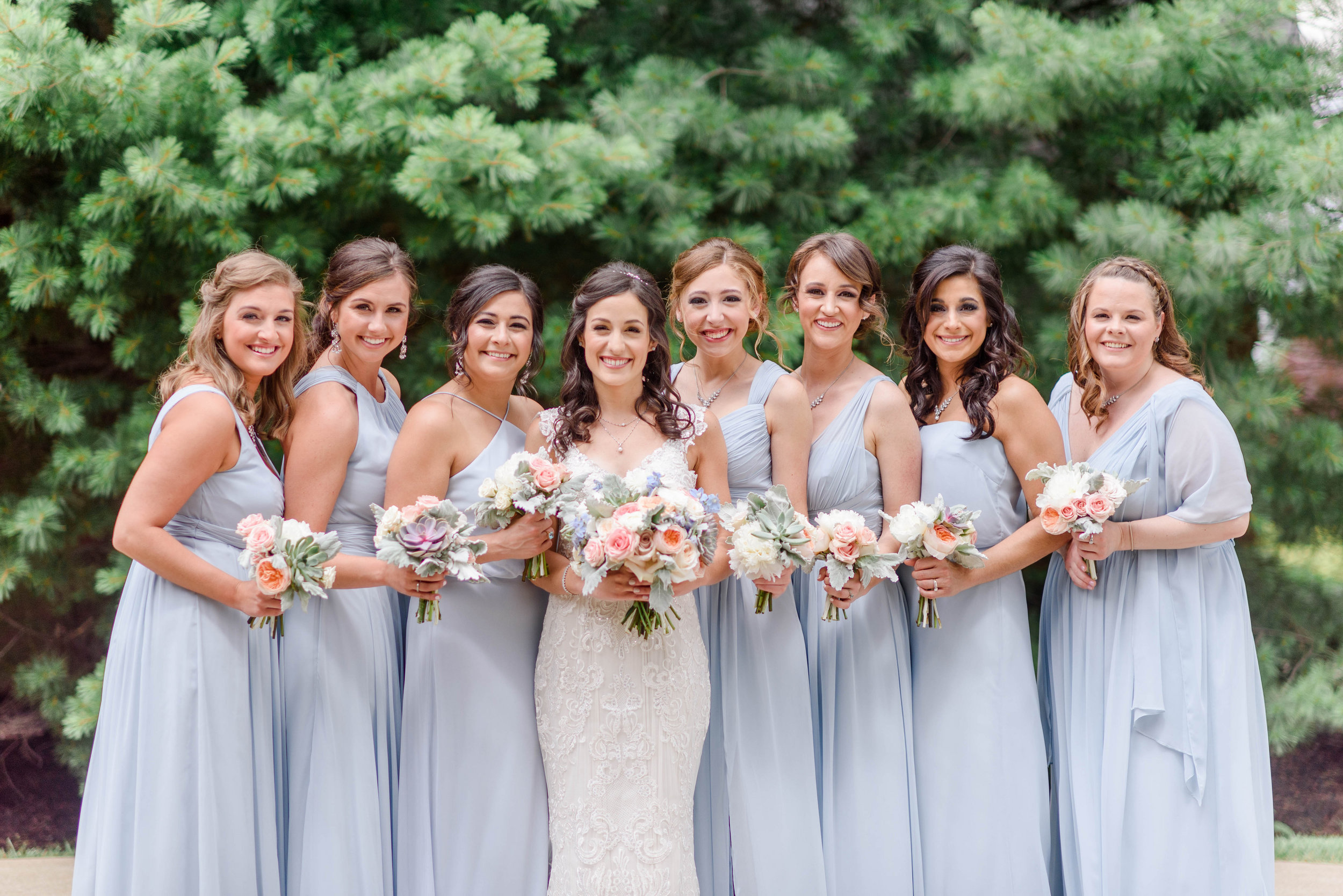 Bridesmaids dress in dusty blue holding wedding bouquets for elegant Greek wedding held in Pittsburgh at Oakmont Country Club. See more details at exhale-events.com!