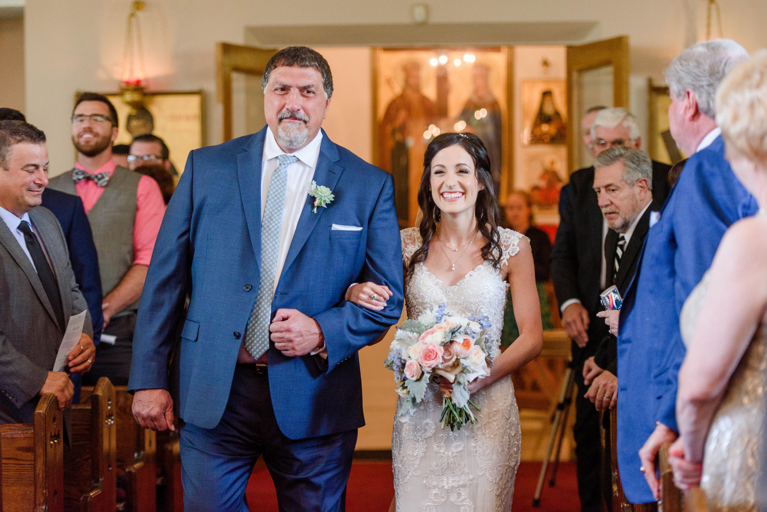 Father escorting bride down the aisle for elegant Greek wedding held in Pittsburgh at Oakmont Country Club. See more details at exhale-events.com!
