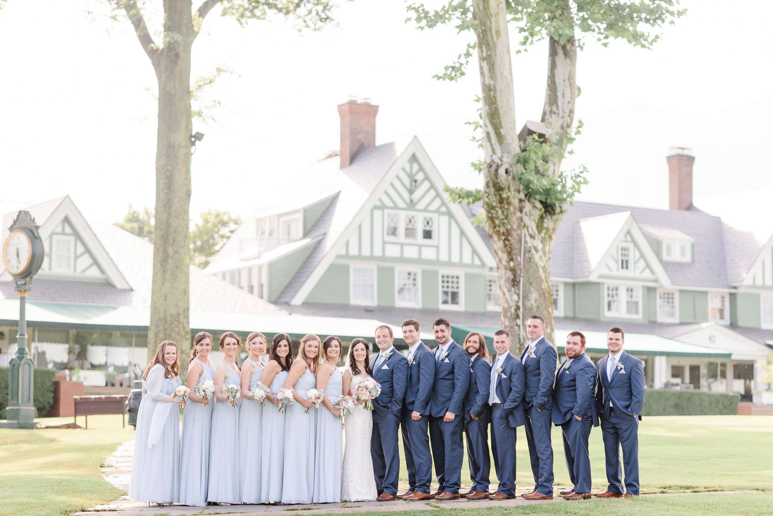 Bridal party dressed in blue for elegant Greek wedding held in Pittsburgh at Oakmont Country Club. See more details at exhale-events.com!
