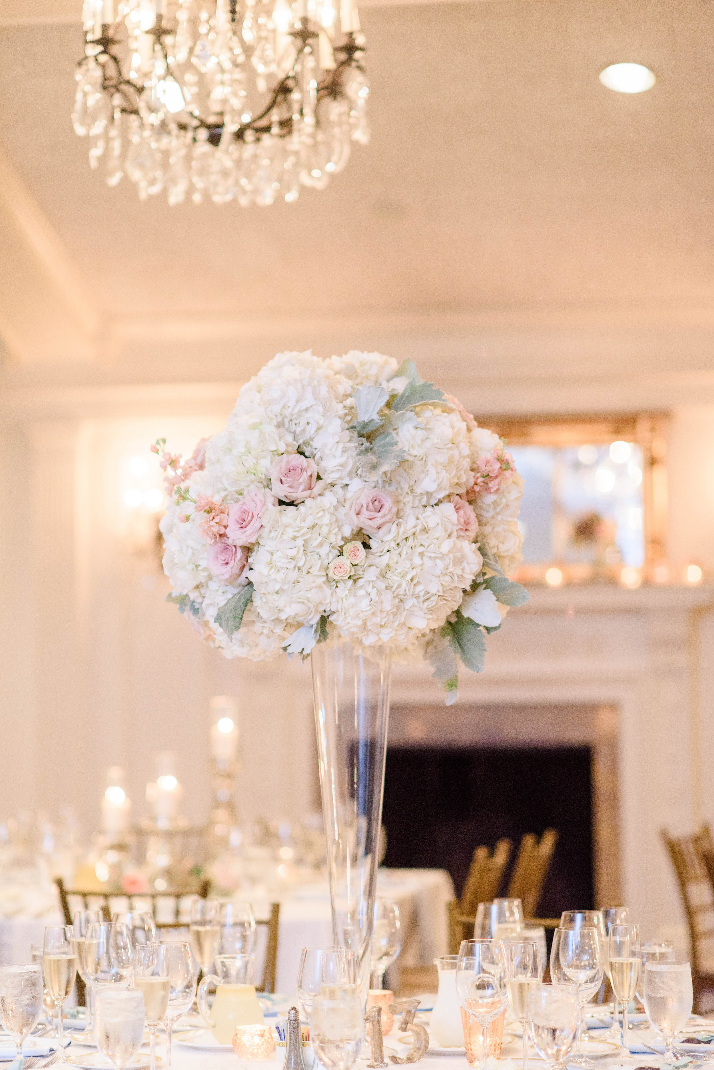 Tall wedding centerpieces with pastel flowers for wedding table for elegant Greek wedding held in Pittsburgh at Oakmont Country Club. See more beautiful details at exhale-events.com!