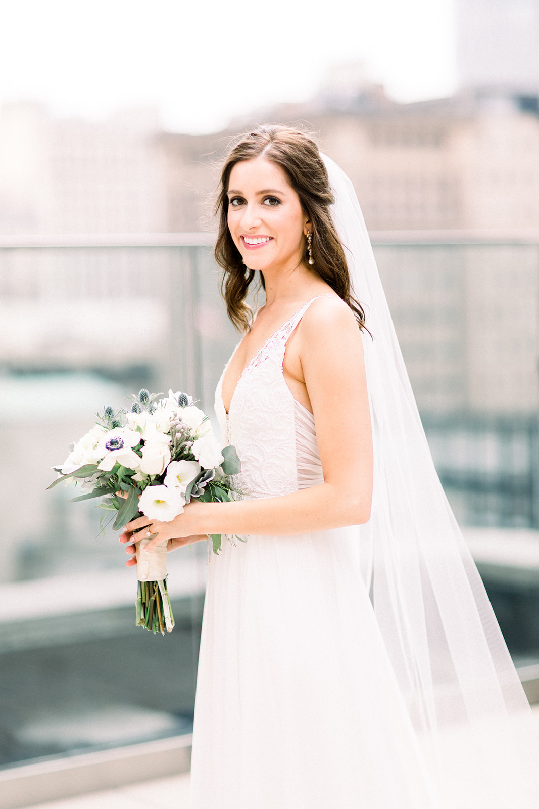 Stunning bride in her wedding dress holding her wedding bouquet for Pittsburgh wedding held at Hotel Monaco. See more beautiful details of this simple, yet stunning wedding at exhale-events.com!