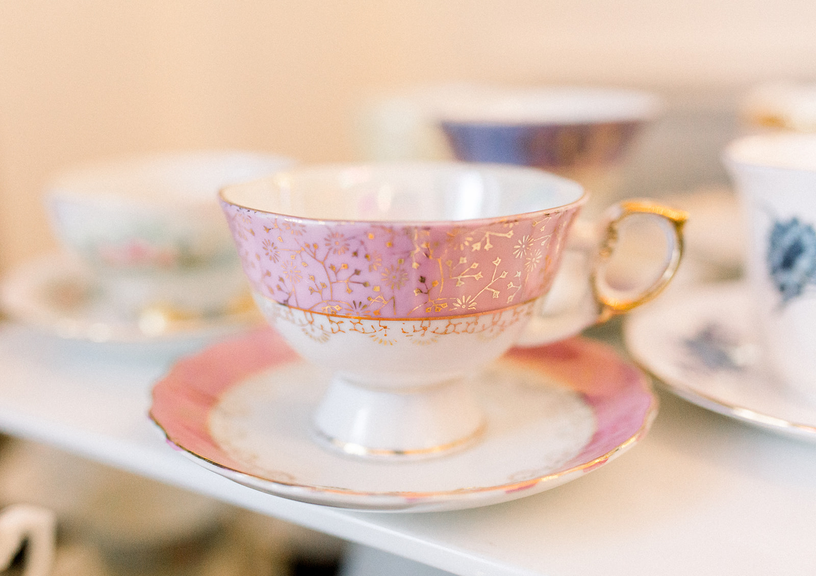 Vintage tea cups displayed at wedding reception for Pittsburgh wedding held at Hotel Monaco. See more beautiful details of this simple, yet stunning wedding at exhale-events.com!