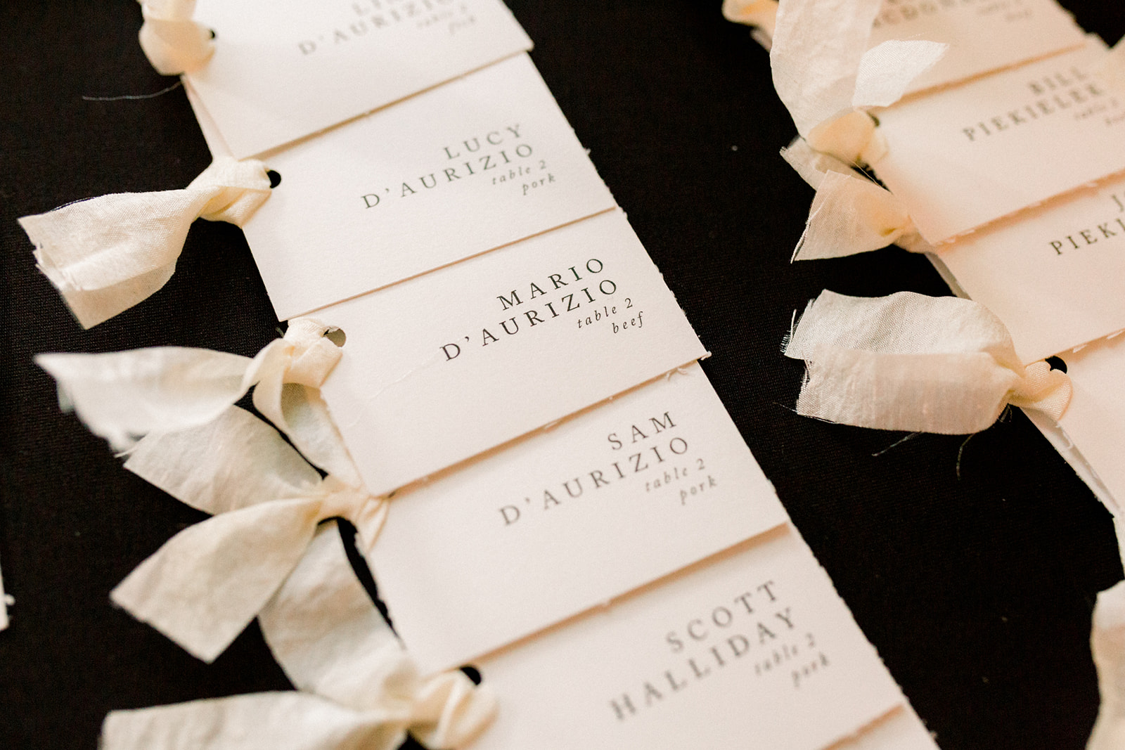 Wedding escort cards with hand-tied ribbon at wedding reception for Pittsburgh wedding held at Hotel Monaco. See more beautiful details of this simple, yet stunning wedding at exhale-events.com!