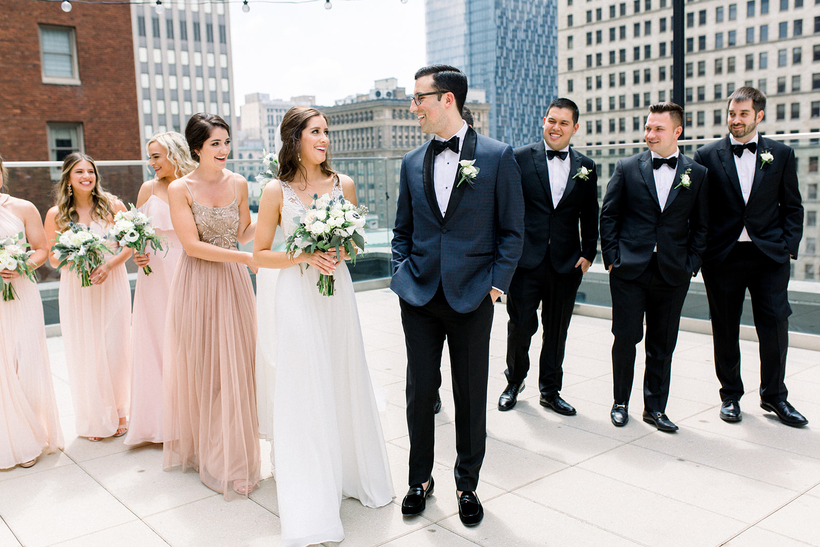 Mismatched, neutral colored bridesmaids dresses and black tuxedos for Pittsburgh wedding held at Hotel Monaco. See more beautiful details of this simple, yet stunning wedding at exhale-events.com!