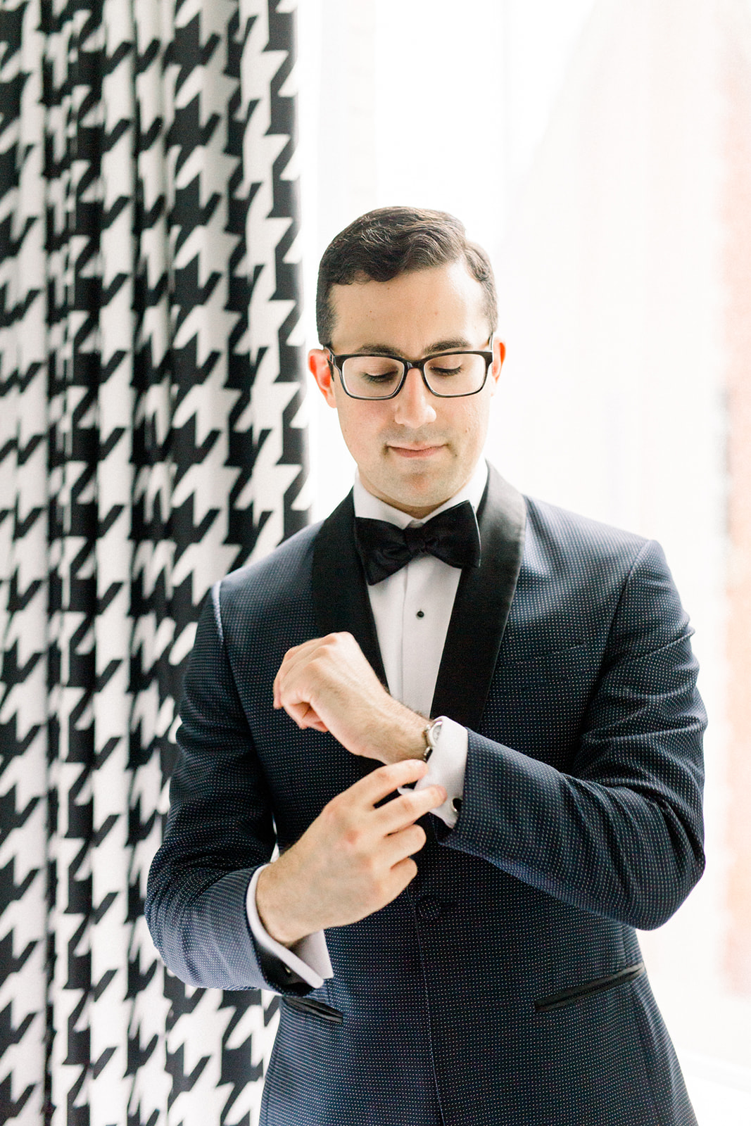 Groom dressed in modern tuxedo for Pittsburgh wedding held at Hotel Monaco. See more beautiful details of this simple, yet stunning wedding at exhale-events.com!