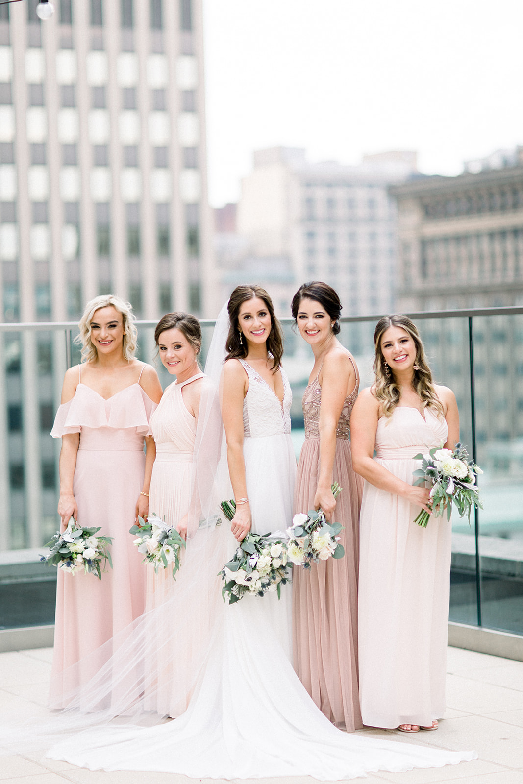 Mismatched soft pink bridesmaids dresses for Pittsburgh wedding held at Hotel Monaco. See more beautiful details of this simple, yet stunning wedding at exhale-events.com!