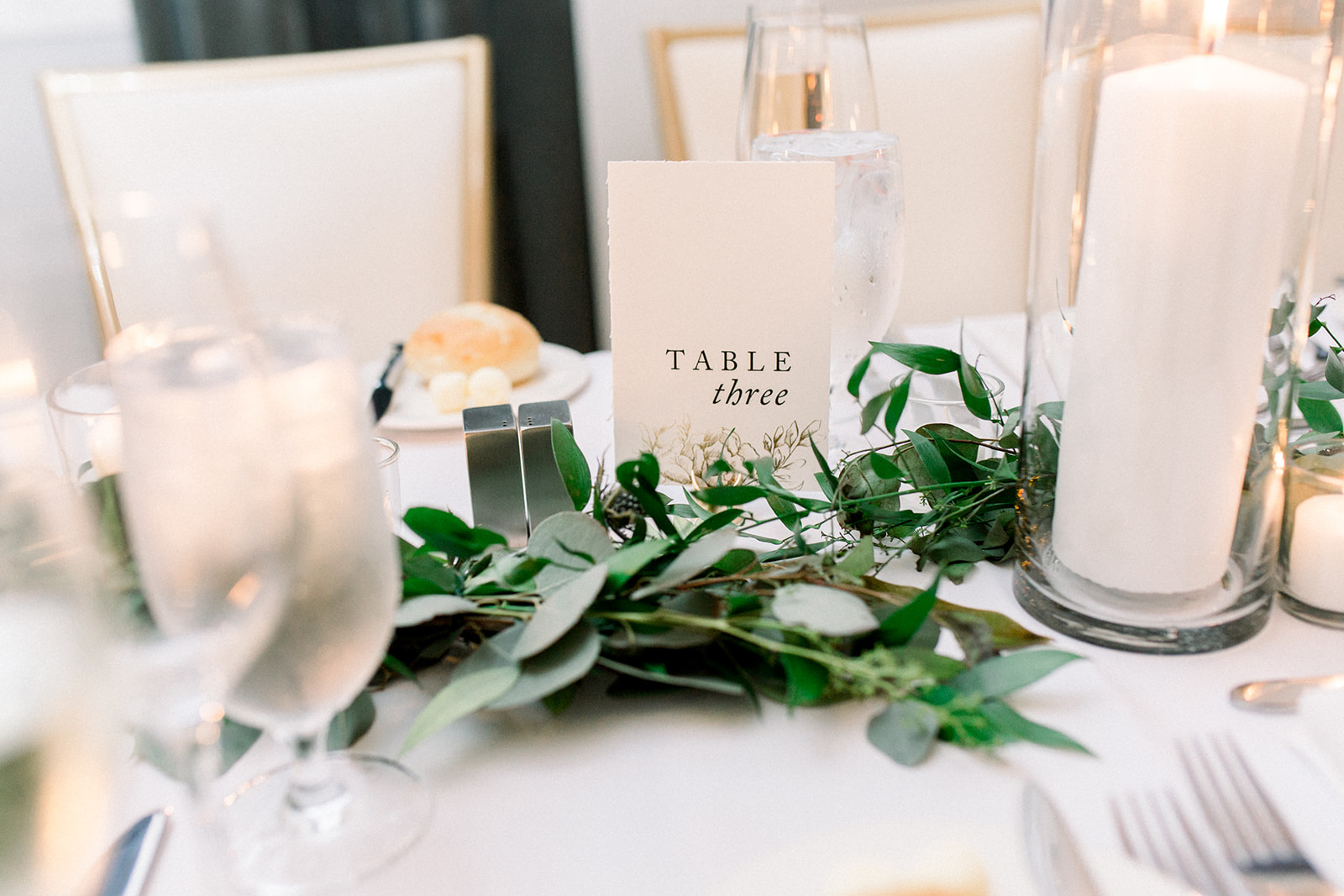 Wedding centerpieces with greenery and organic paper table numbers for Pittsburgh wedding held at Hotel Monaco. See more beautiful details of this simple, yet stunning wedding at exhale-events.com!