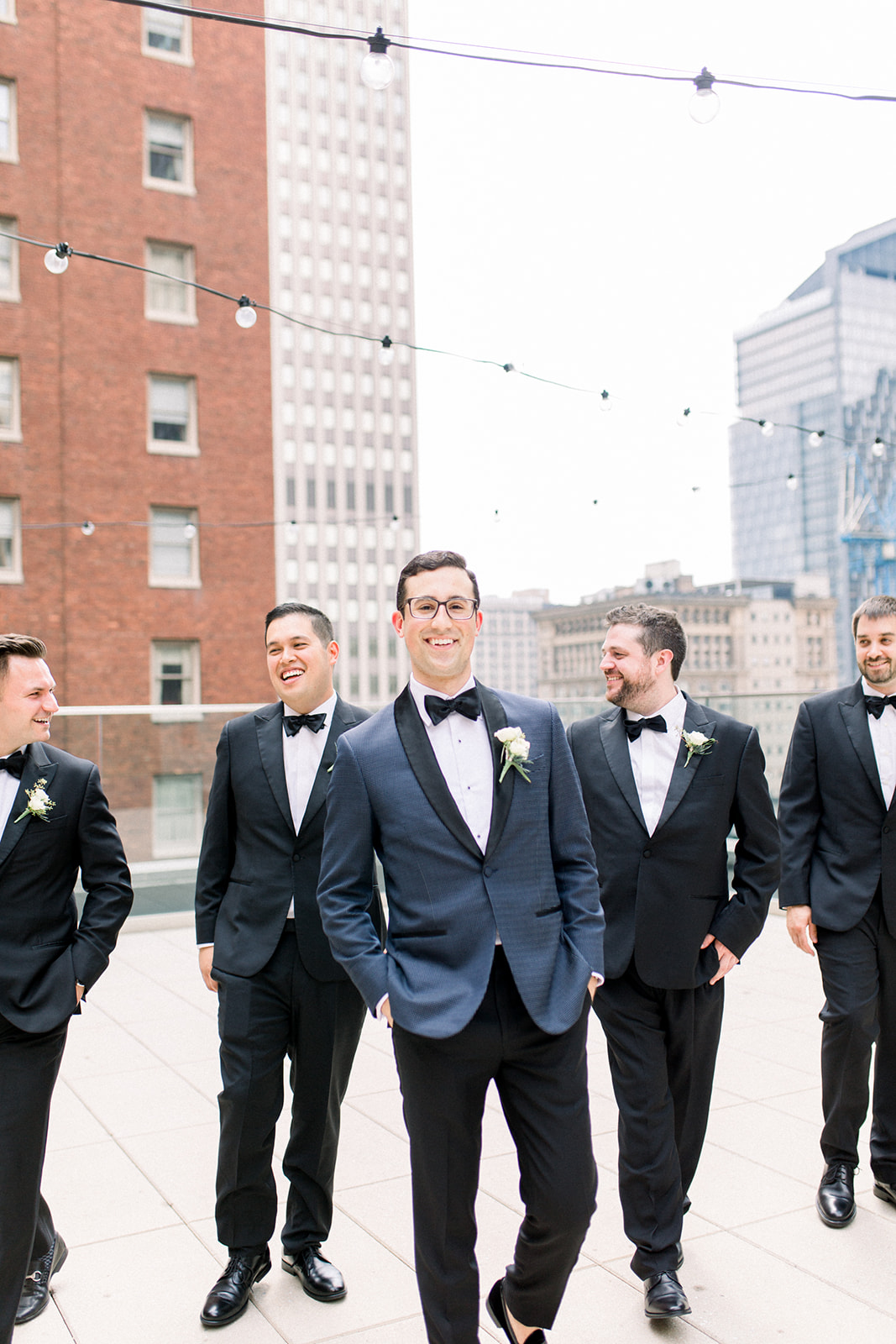 Modern groomsmen attire with black tuxedo for Pittsburgh wedding held at Hotel Monaco. See more beautiful details of this simple, yet stunning wedding at exhale-events.com!