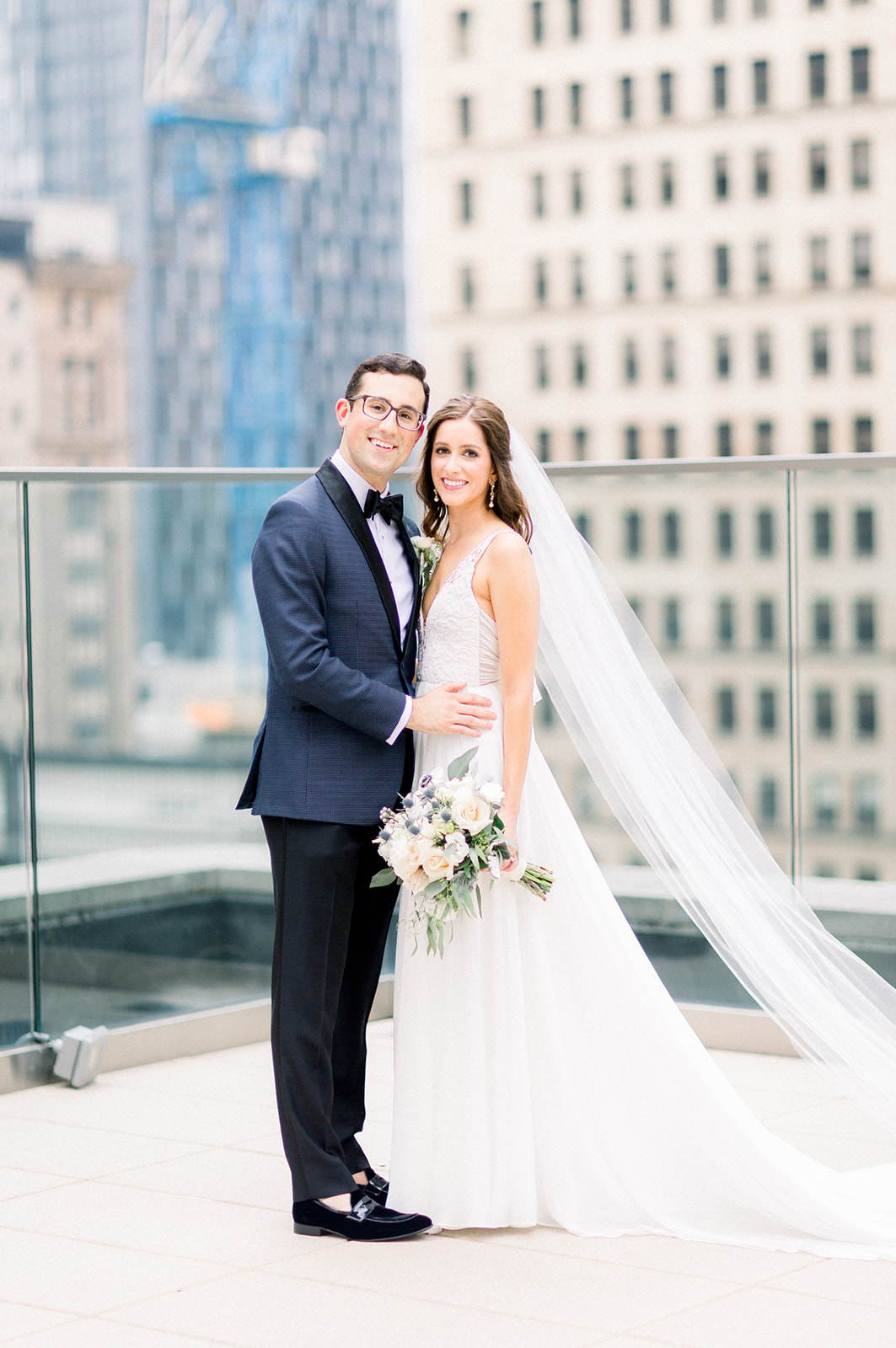 Bride and groom take wedding photos for Pittsburgh wedding held at Hotel Monaco. See more beautiful details of this simple, yet stunning wedding at exhale-events.com!