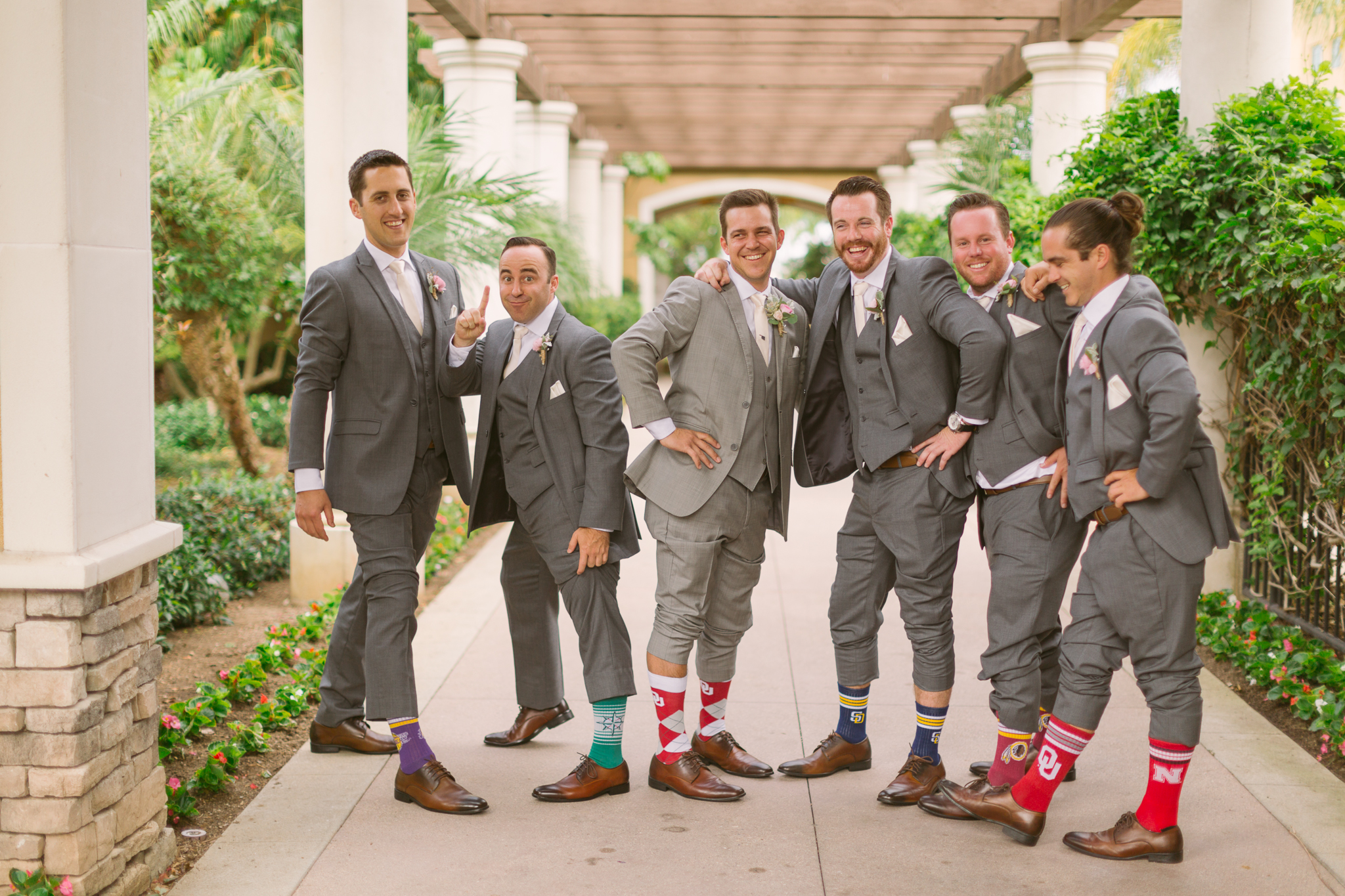 Groom and groomsmen take wedding photos for San Diego, California outdoor wedding planned by Exhale Events. See all the beautiful details at exhale-events.com!
