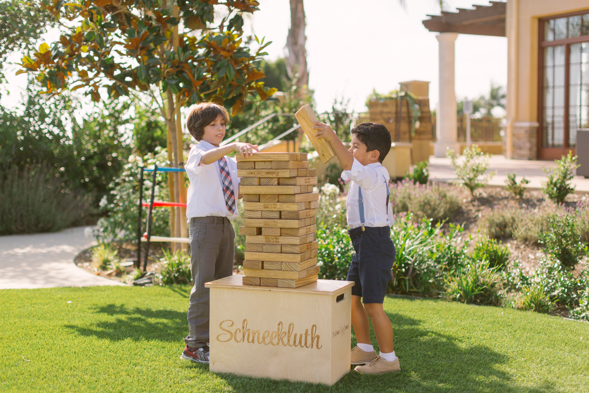 Customized Jenga game to entertain guests at San Diego, California outdoor wedding planned by Exhale Events. See all the beautiful details at exhale-events.com!
