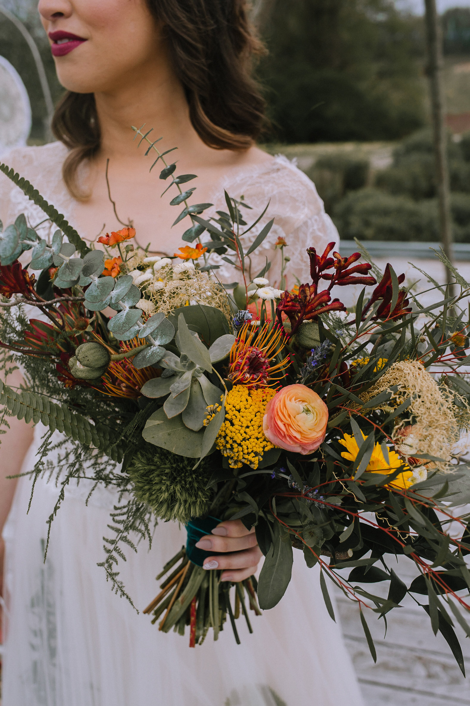 Boho bride with wedding bouquet for fall vintage boho styled shoot designed by exhale events. Get inspired by these gorgeous wedding details at exhale-events.com!