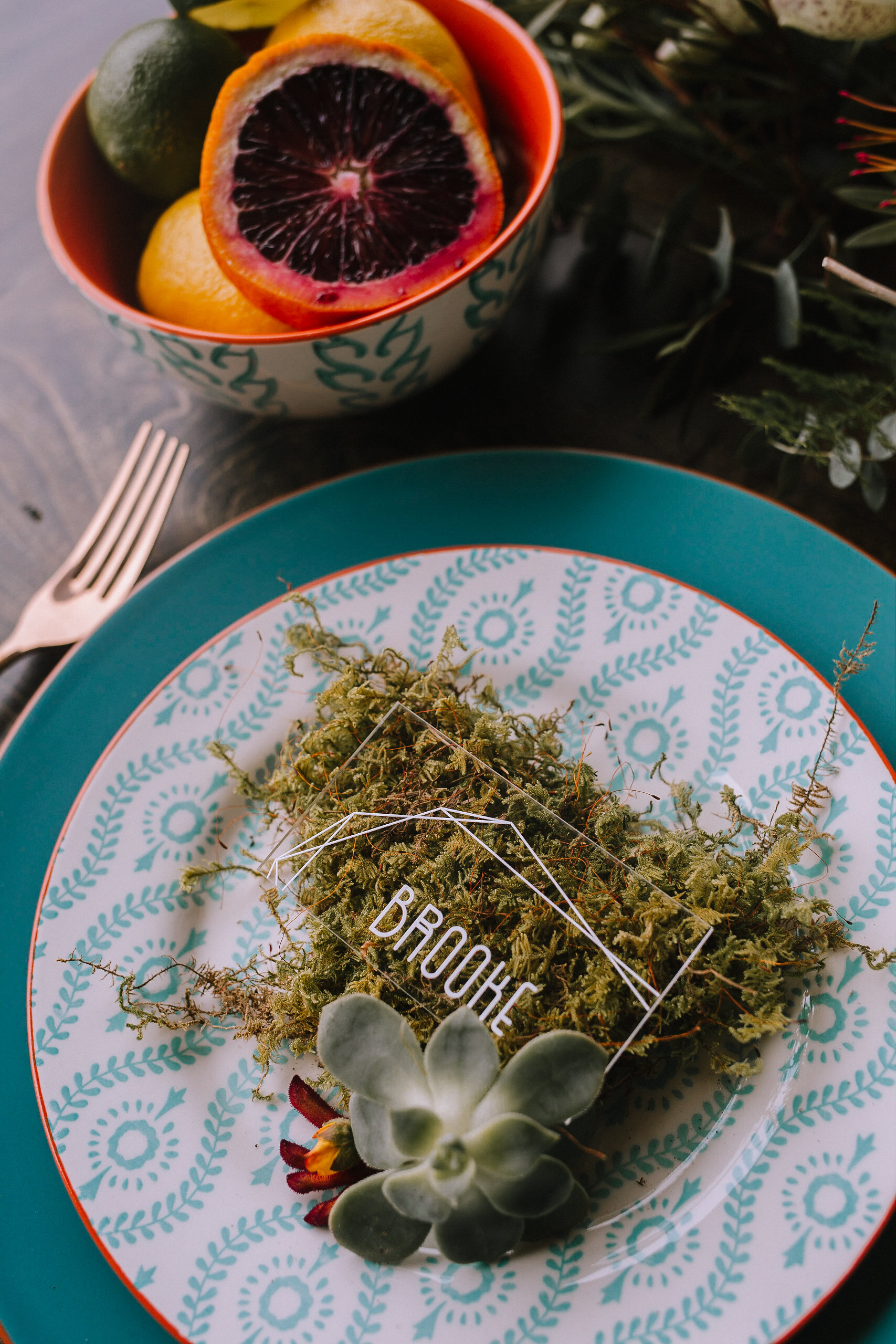 Acrylic escort card with moss at wedding table setting for fall vintage boho styled shoot designed by exhale events. Get inspired by these gorgeous wedding details at exhale-events.com!