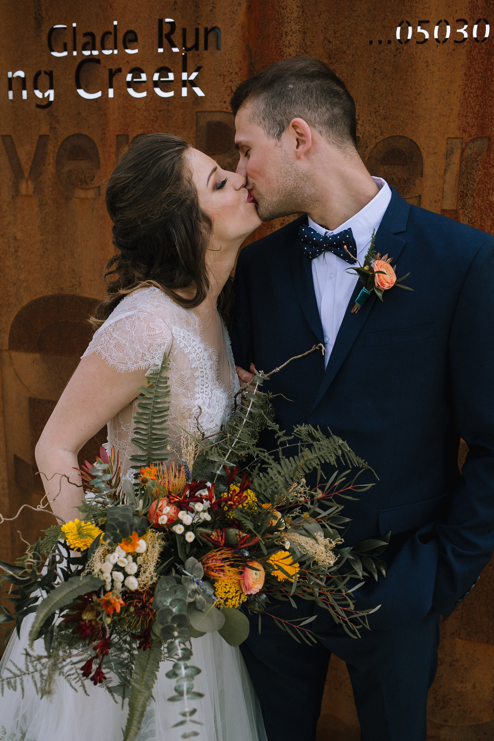 Boho bride and groom pose with wedding bouquet for fall vintage boho styled shoot designed by exhale events. Get inspired by these gorgeous wedding details at exhale-events.com!
