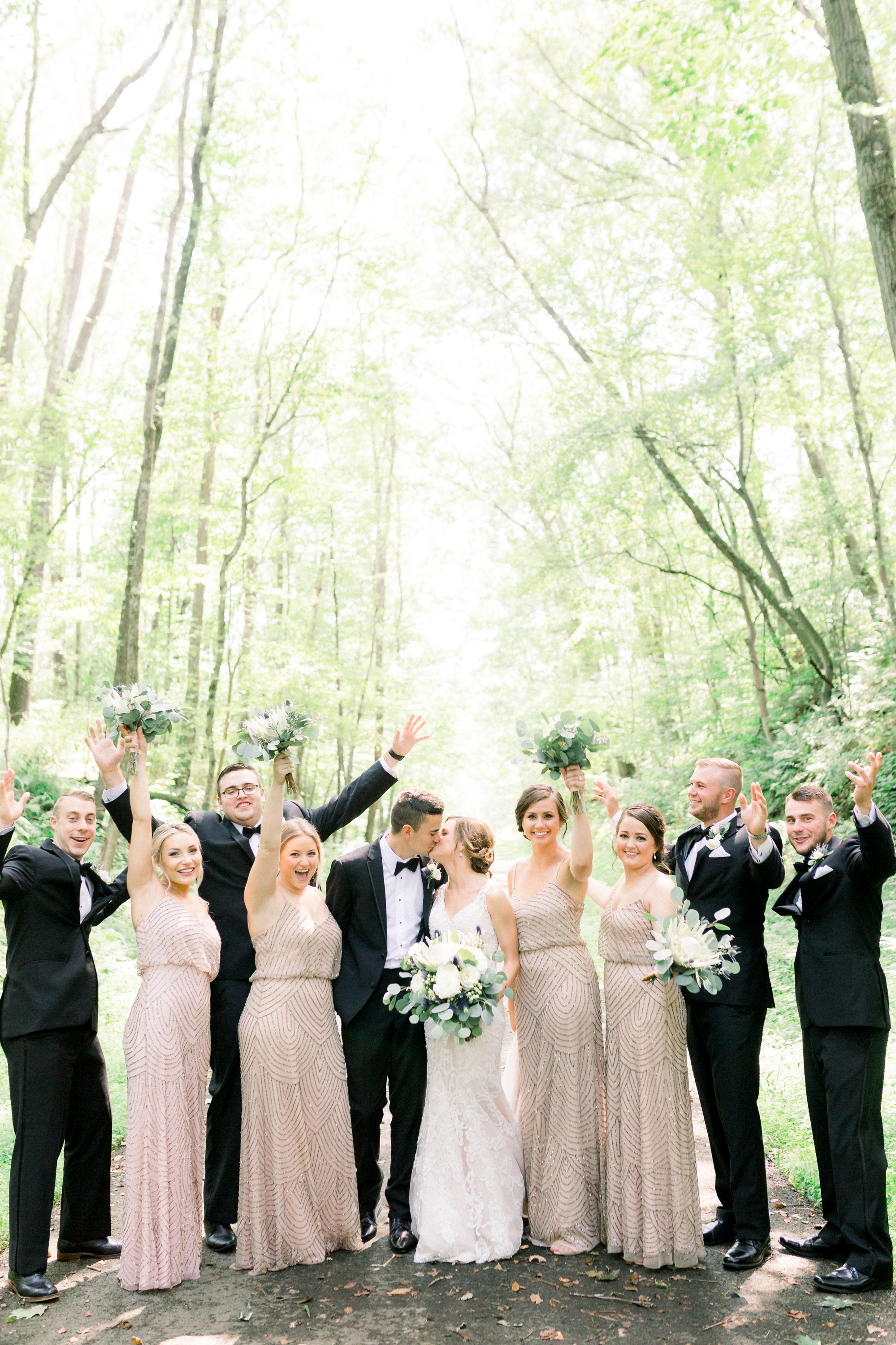Bride and groom take wedding photos with bridal party for Pittsburgh wedding planned by Exhale Events. Find more wedding inspiration at exhale-events.com!