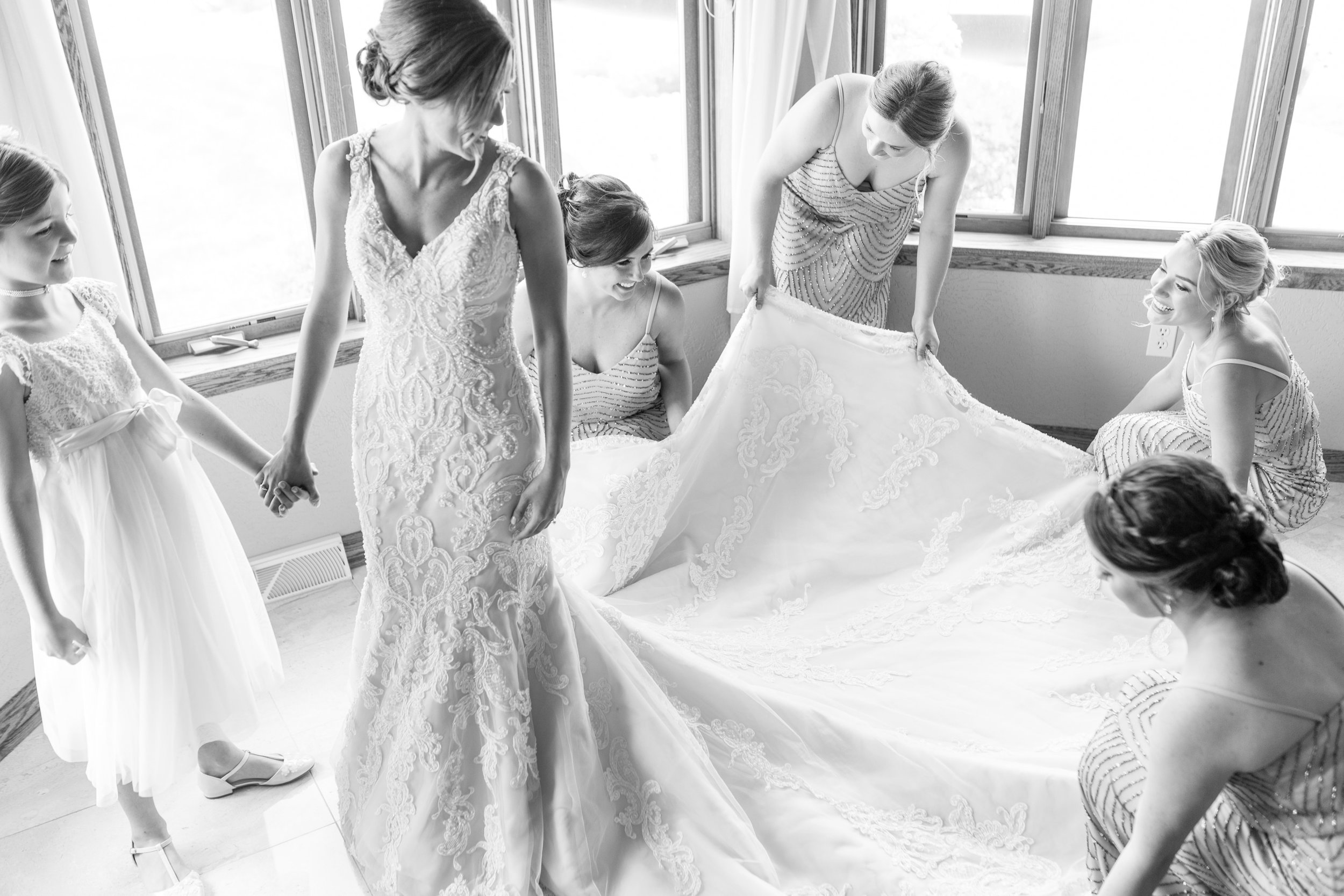 Bride getting into wedding dress with cathedral length train for Pittsburgh wedding planned by Exhale Events. Find more wedding inspiration at exhale-events.com!