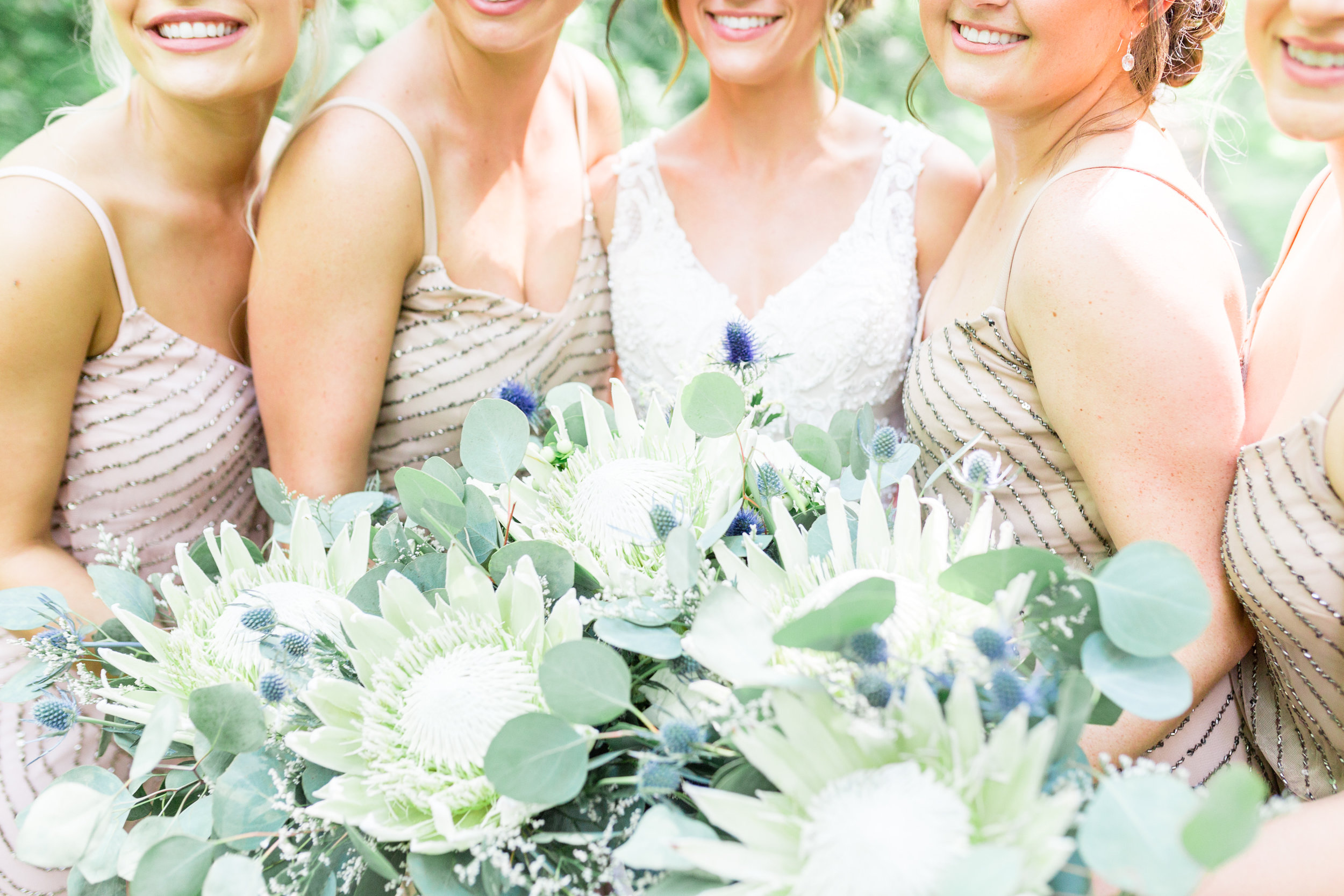 King protea wedding bouquets with greenery for Pittsburgh wedding planned by Exhale Events. Find more wedding inspiration at exhale-events.com!