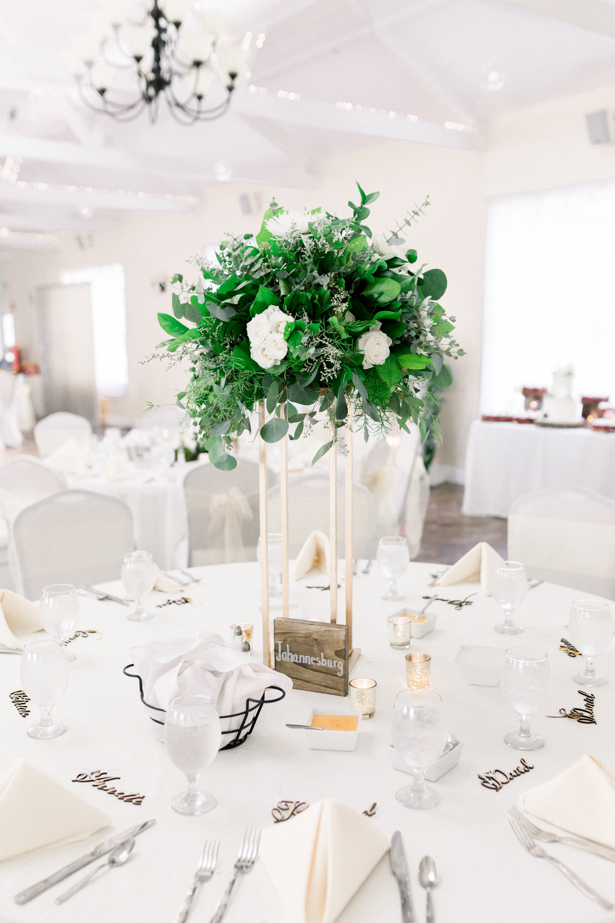 Tall wedding centerpieces with gold and wooden accents for Pittsburgh wedding planned by Exhale Events. Find more wedding inspiration at exhale-events.com!