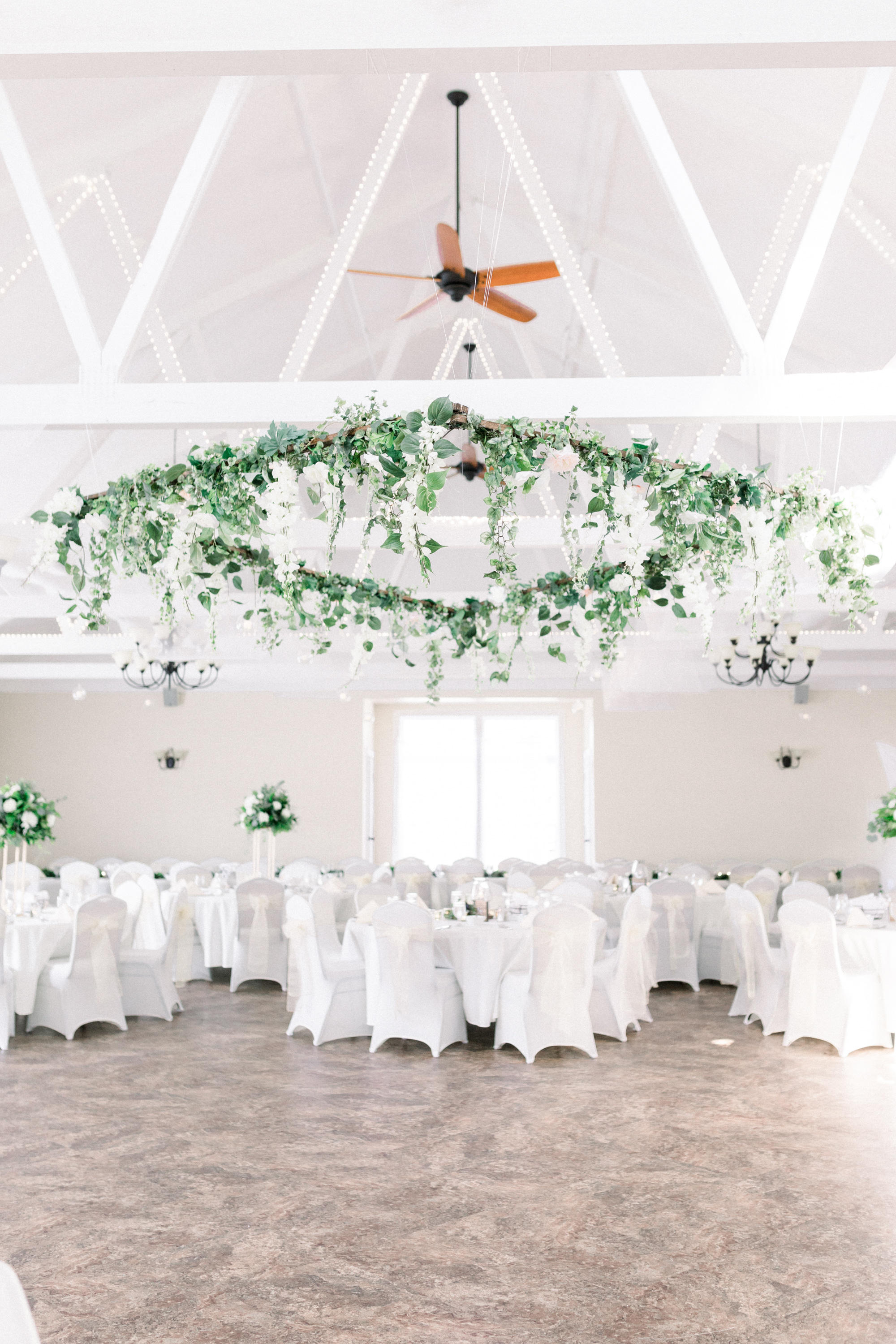 DIY hanging floral wreath above dance floor for Pittsburgh wedding planned by Exhale Events. Find more wedding inspiration at exhale-events.com!