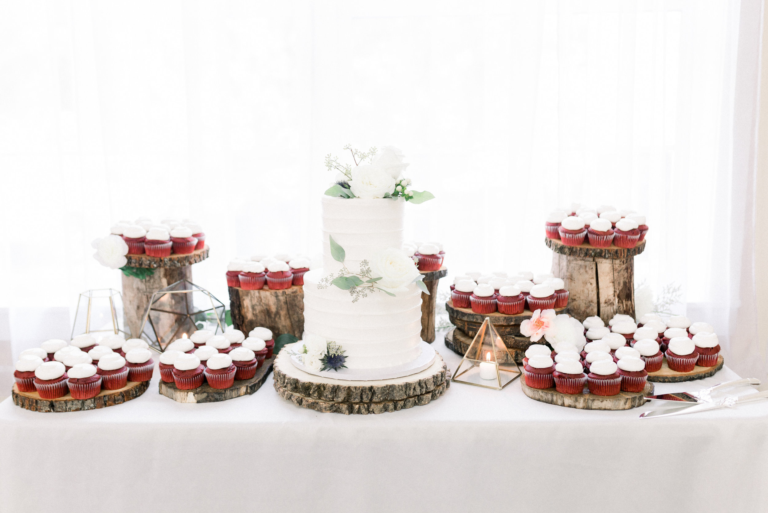 Wedding cake and dessert table on wood platforms for Pittsburgh wedding planned by Exhale Events. Find more wedding inspiration at exhale-events.com!