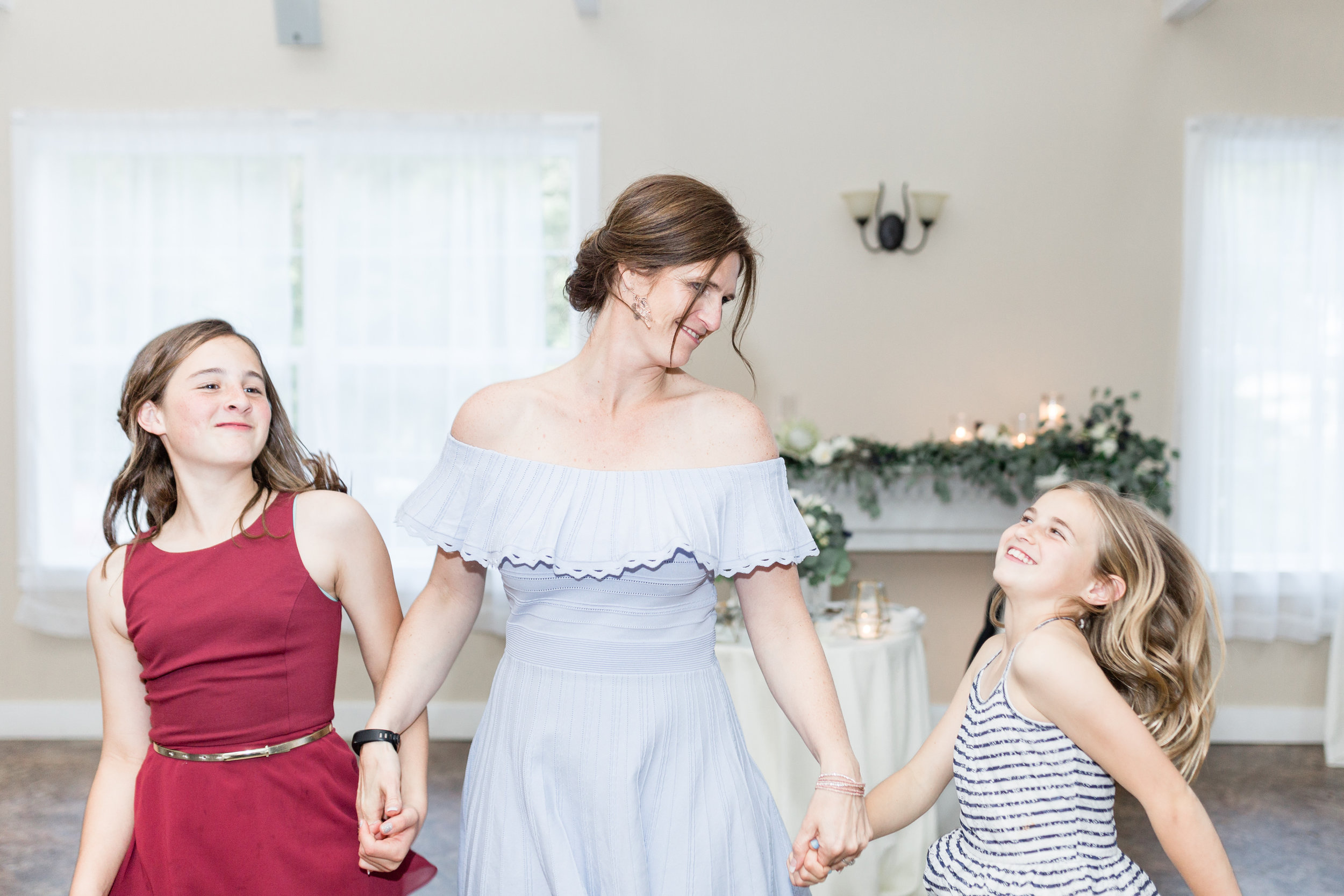 Family dancing and celebrating at Pittsburgh wedding planned by Exhale Events. Find more wedding inspiration at exhale-events.com!