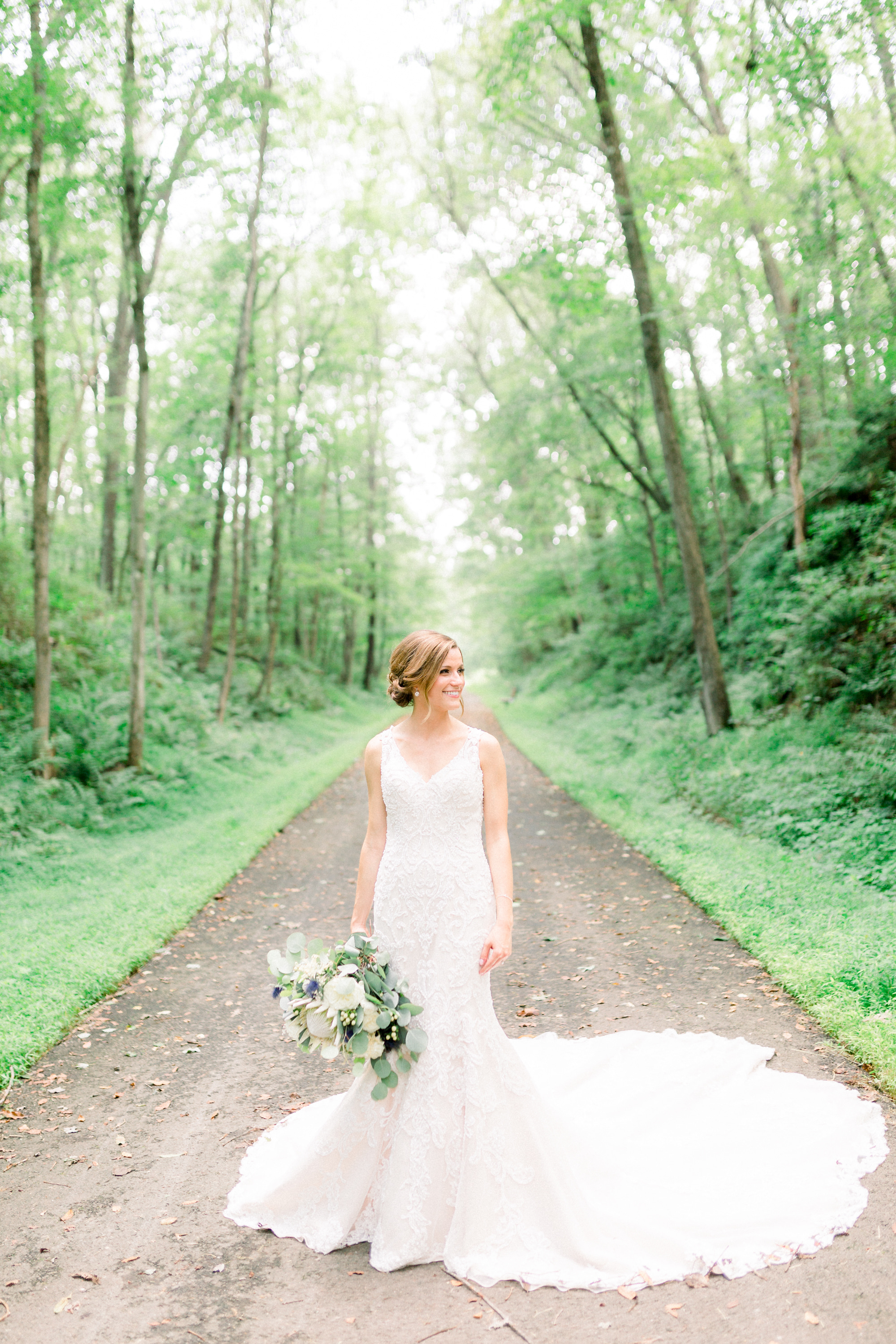 Bride in Justin Alexander wedding dress for Pittsburgh wedding planned by Exhale Events. Find more wedding inspiration at exhale-events.com!