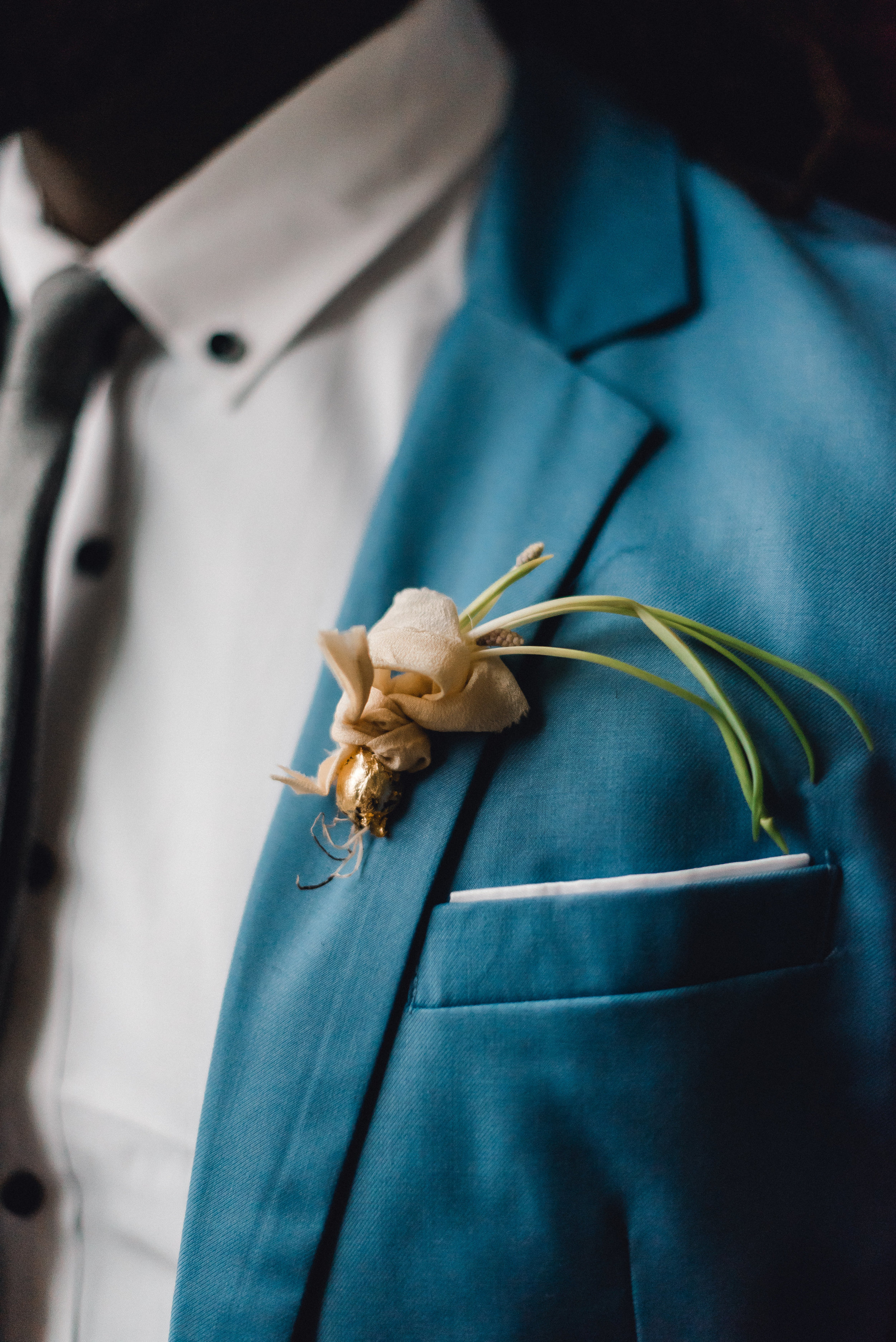 Groom's boutonniere for Pablo Neruda enchanting garden styled shoot planned by Exhale Events. Get inspired at exhale-events.com!