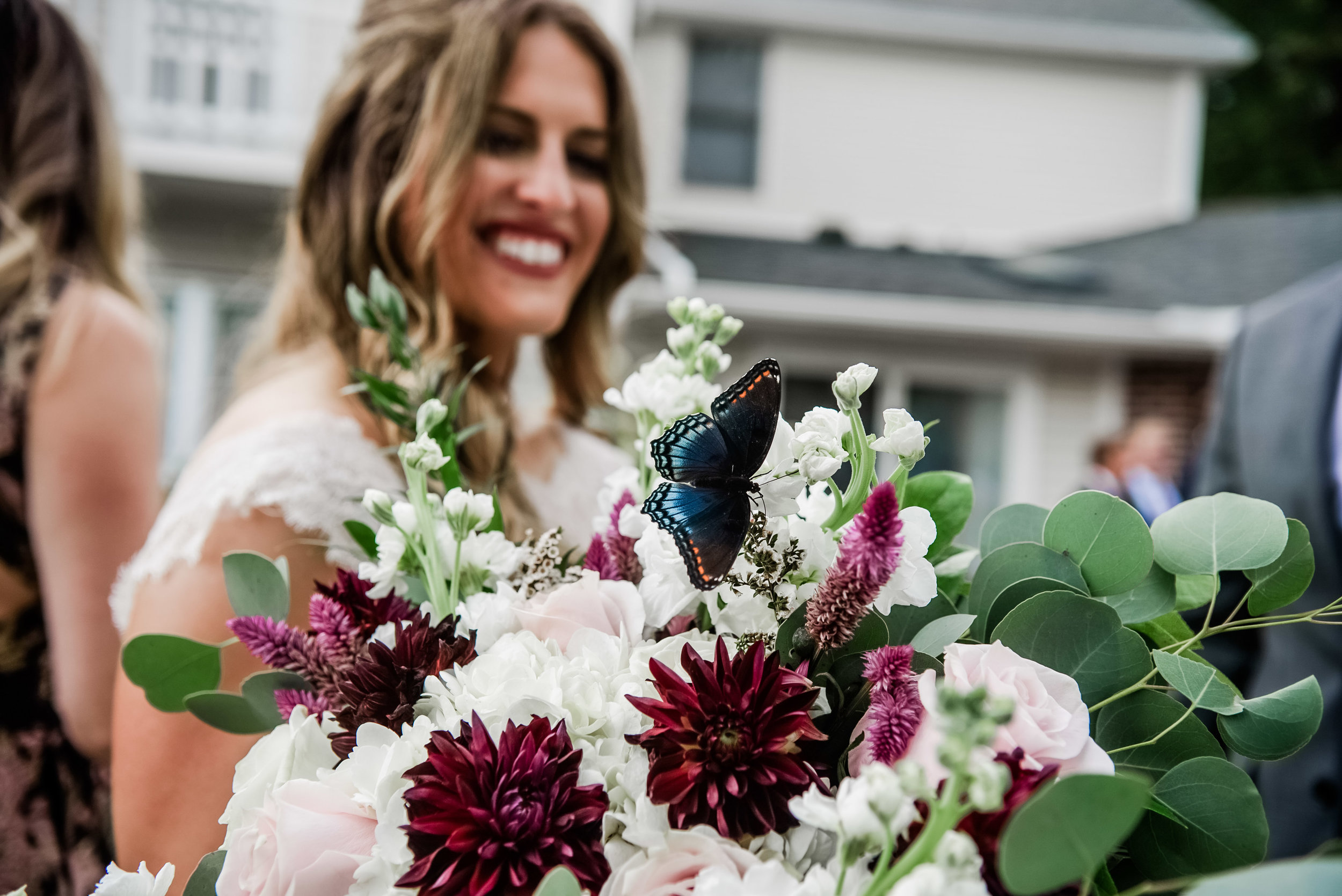 Bride with burgundy wedding bouquet at Pittsburgh wedding planned by Exhale Events. Find more wedding inspiration at exhale-events.com!