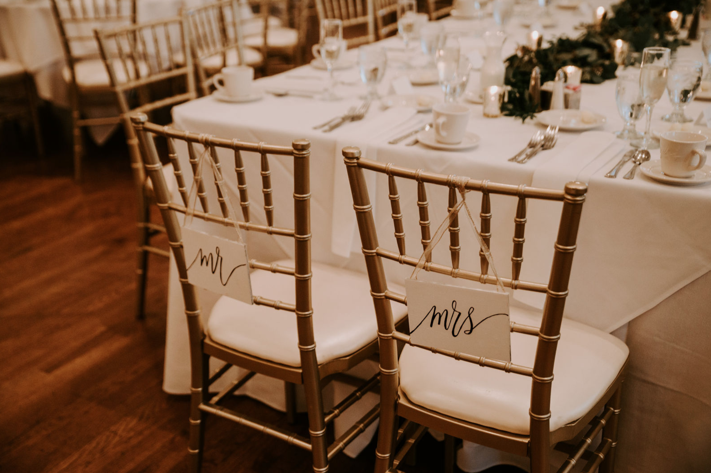 Wedding chair signs at Buffalo, NY wedding planned by Exhale Events. Find more wedding inspiration at exhale-events.com!