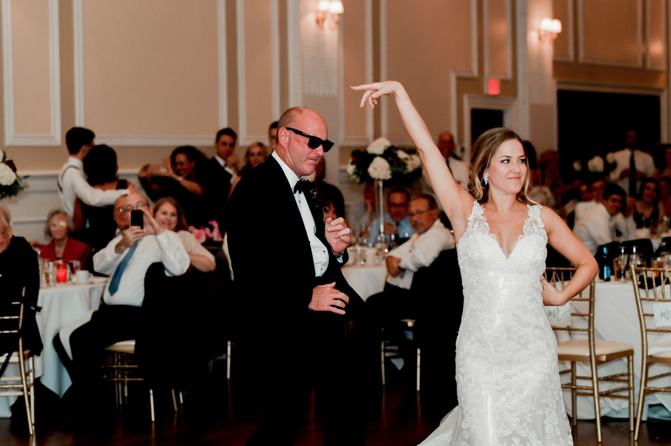 Father of the bride and bride share a fun father/daughter dance at Buffalo, NY wedding planned by Exhale Events. Find more wedding inspiration at exhale-events.com!