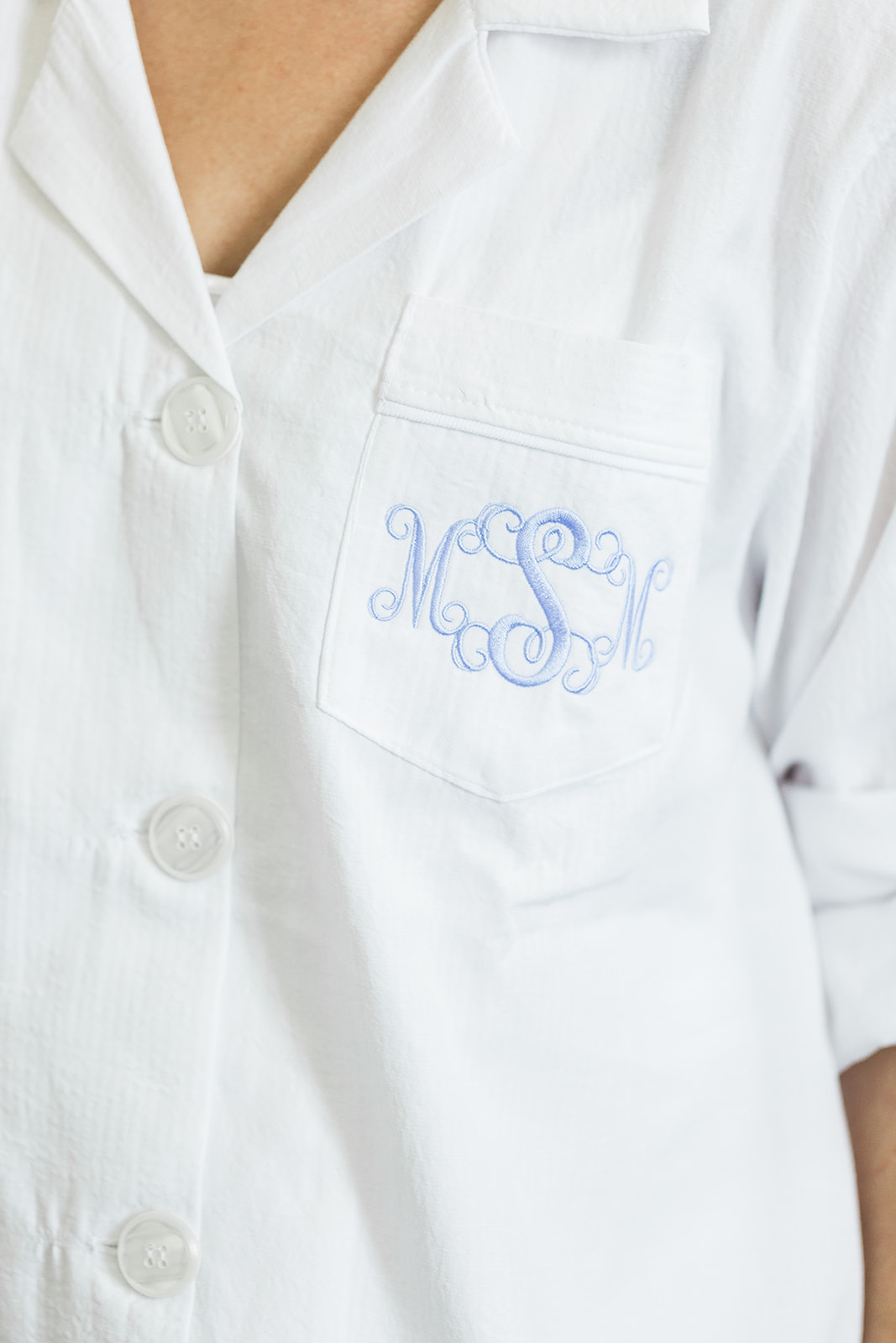 Bride's monogrammed shirt as she gets ready for Pittsburgh wedding at PNC Park planned by Exhale Events. Find more wedding inspiration at exhale-events.com!