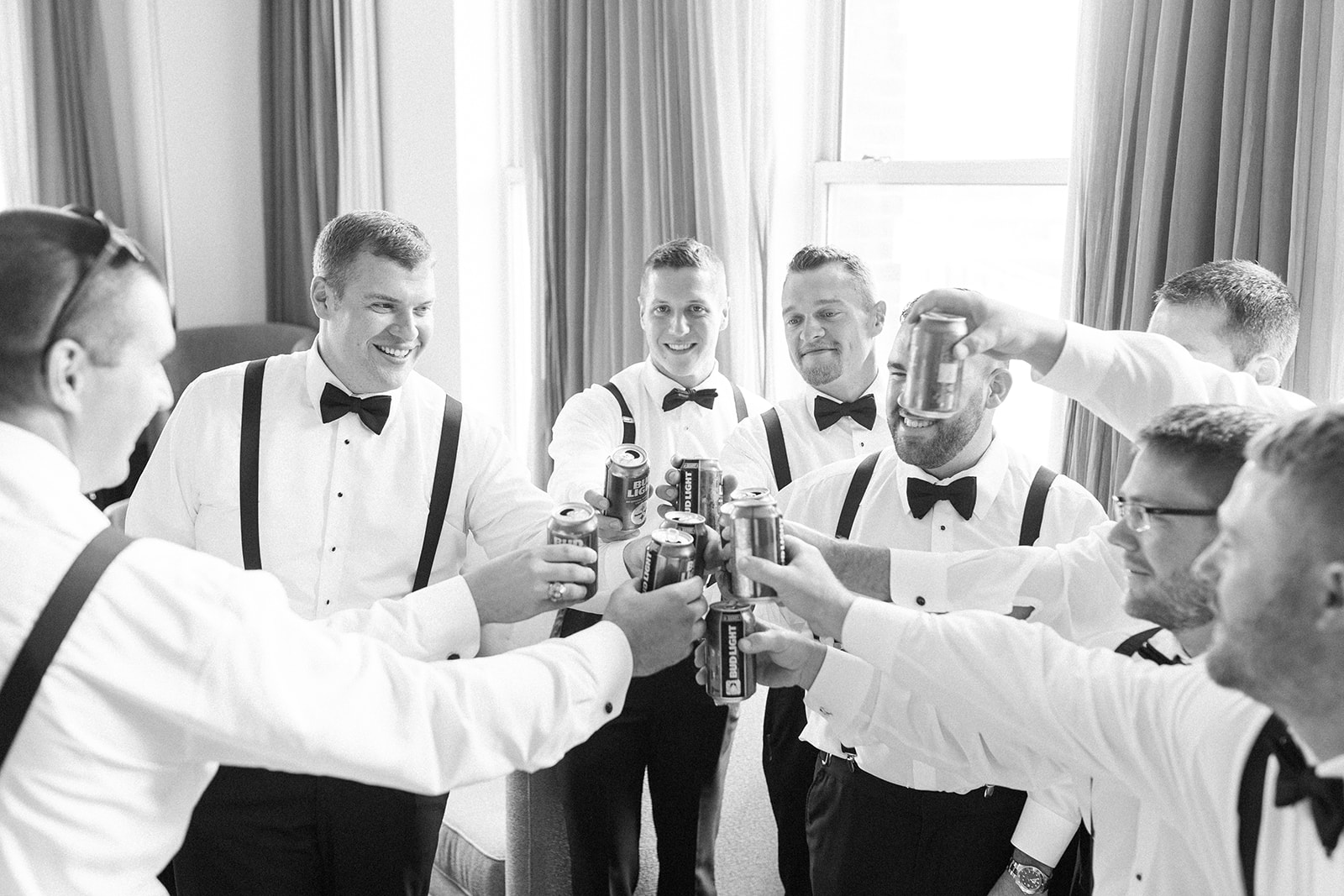 Groom and groomsmen getting ready in black tuxedos and bow ties for Pittsburgh wedding at PNC Park planned by Exhale Events. Find more wedding inspiration at exhale-events.com!