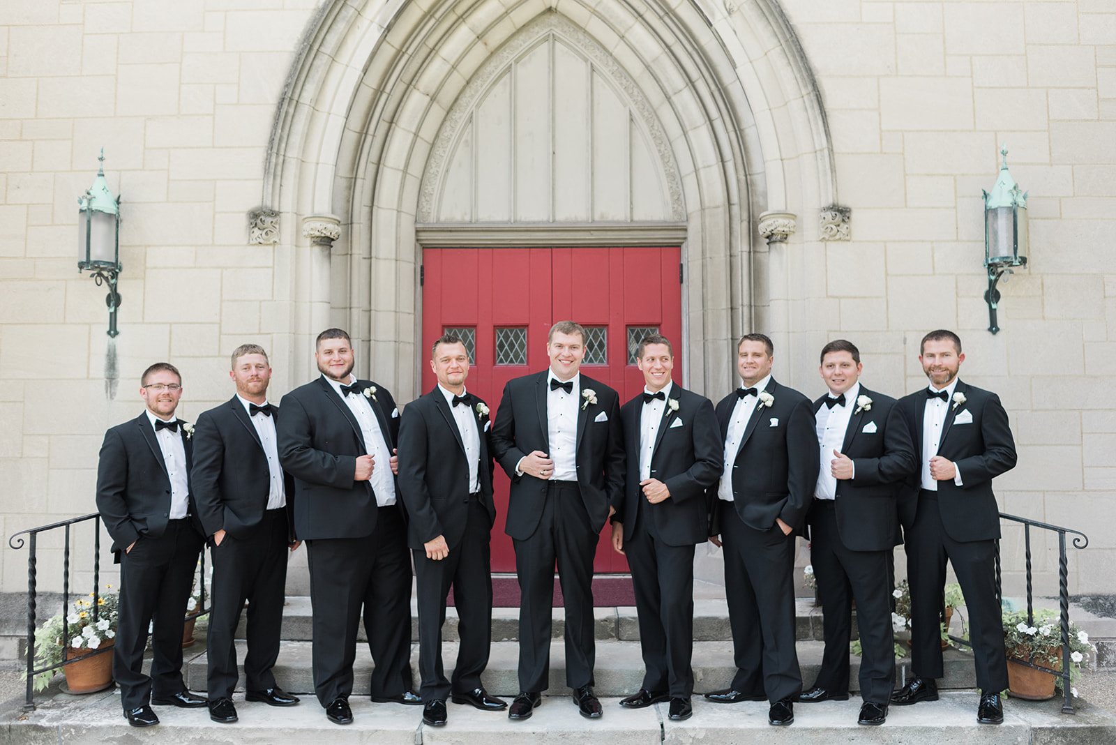 Groom and groomsmen pose for wedding photos in black tuxedos for Pittsburgh wedding at PNC Park planned by Exhale Events. Find more wedding inspiration at exhale-events.com!