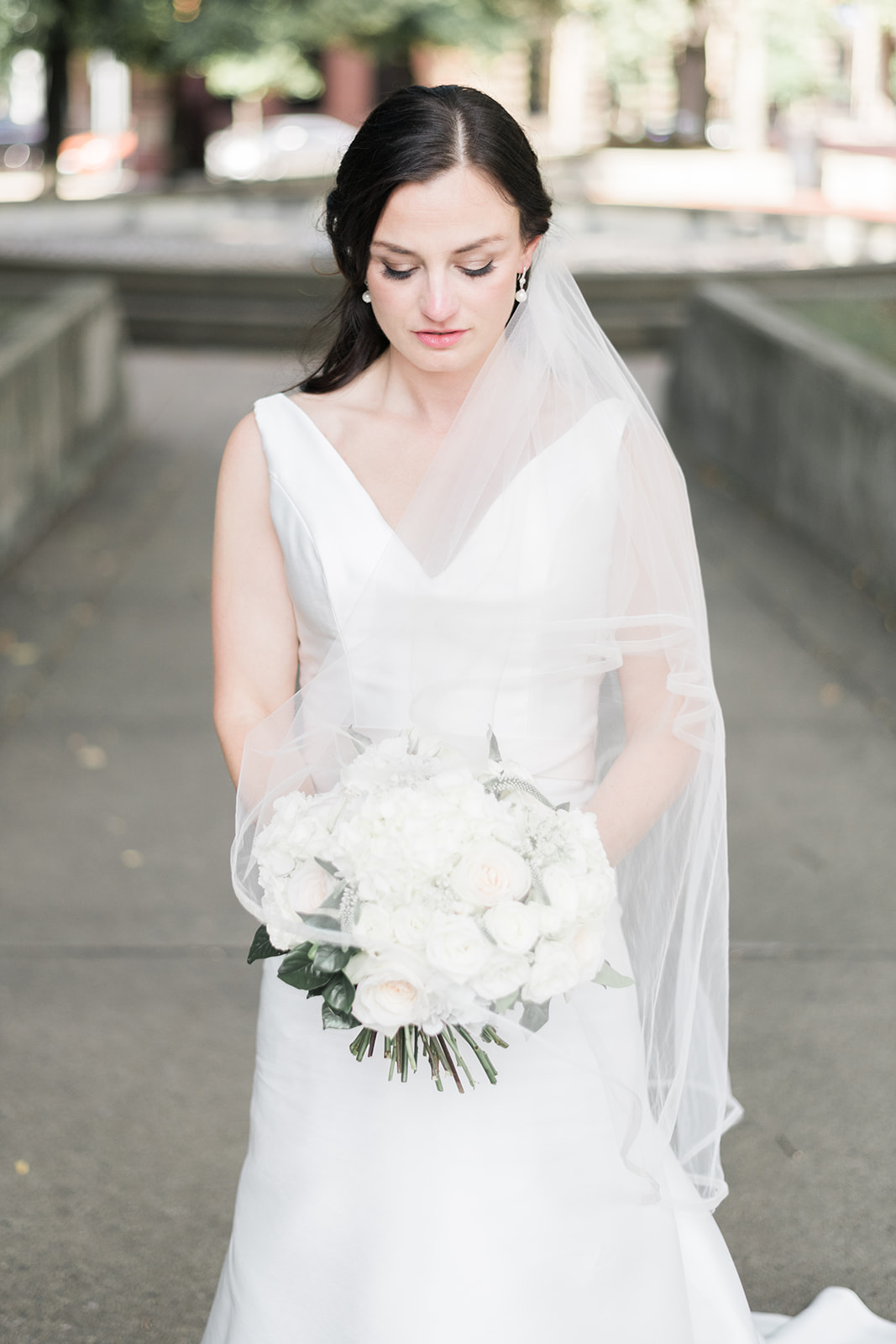 Bride poses for wedding photo with white wedding bouquet for Pittsburgh wedding at PNC Park planned by Exhale Events. Find more wedding inspiration at exhale-events.com!