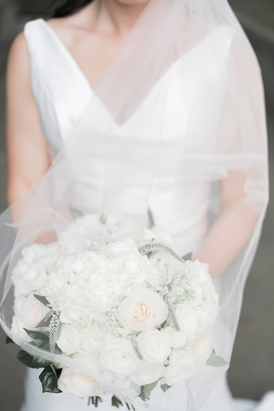 Bride holding white wedding bouquet for Pittsburgh wedding at PNC Park planned by Exhale Events. Find more wedding inspiration at exhale-events.com!