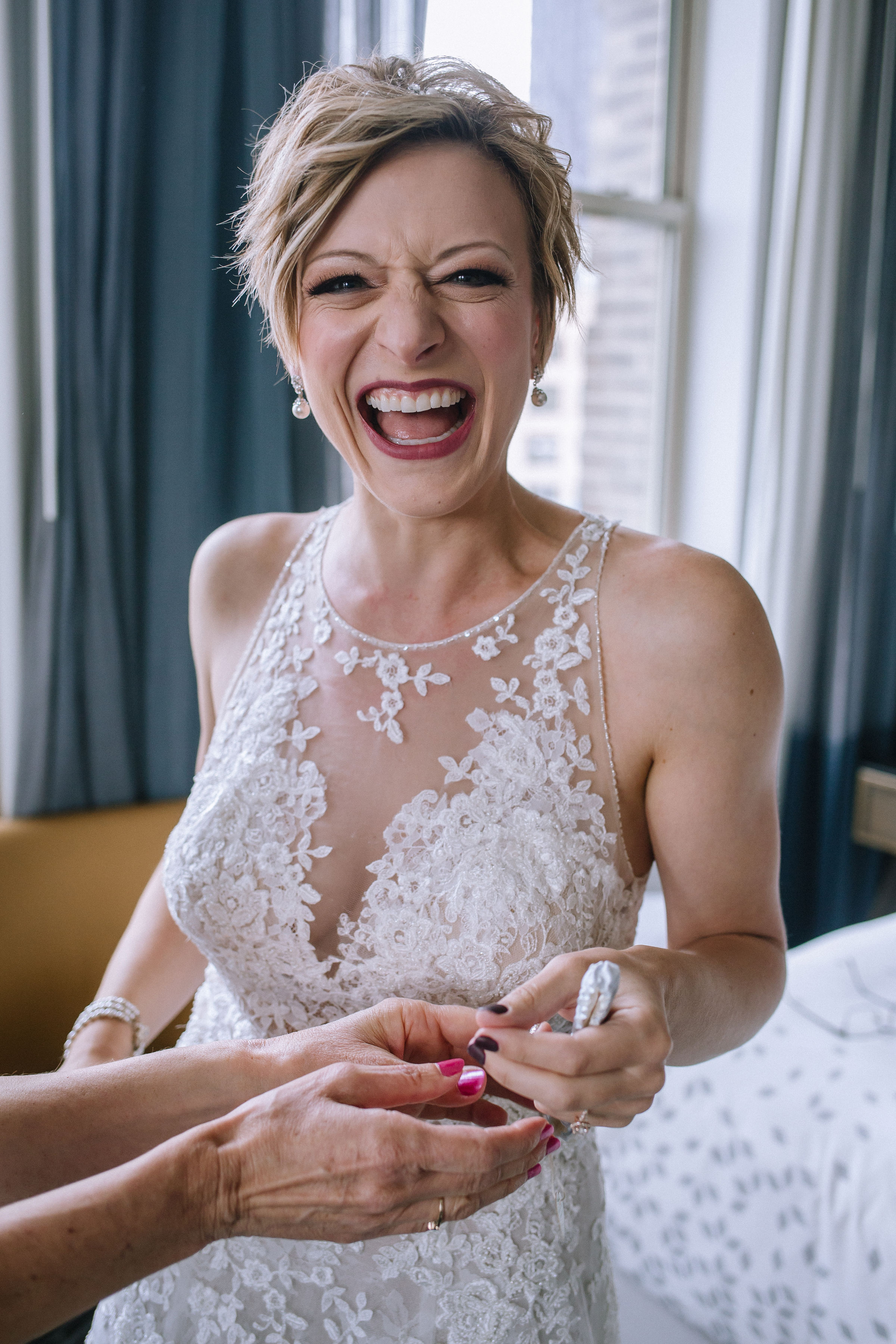 Bride all ready in her embellished wedding dress for Pittsburgh wedding at Studio Slate planned by Exhale Events. Find more wedding inspiration at exhale-events.com!