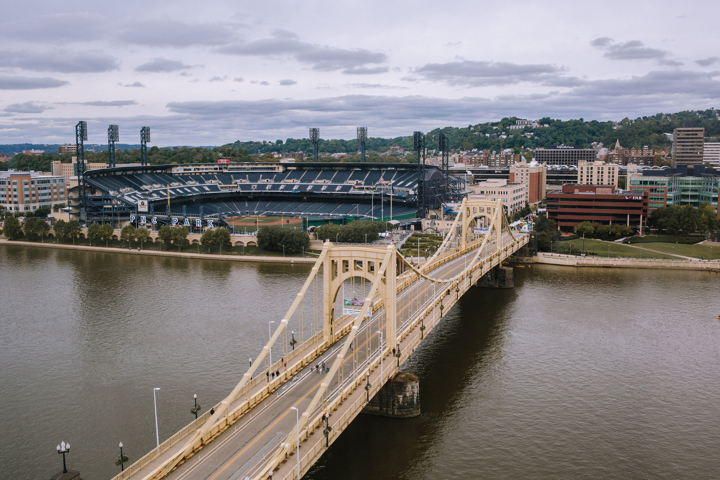 View of the city with bridge for Pittsburgh wedding at Studio Slate planned by Exhale Events. Find more wedding inspiration at exhale-events.com!