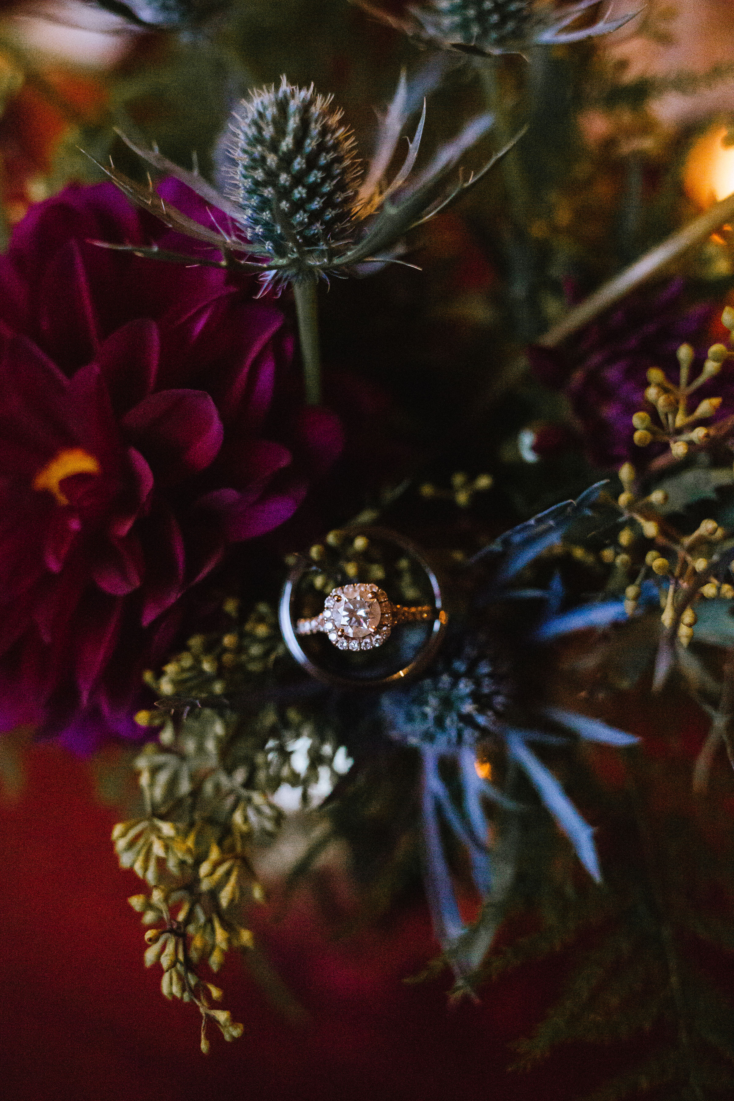 Wedding ring placed in wedding bouquet with blue thistle for Pittsburgh wedding at Studio Slate planned by Exhale Events. Find more wedding inspiration at exhale-events.com!