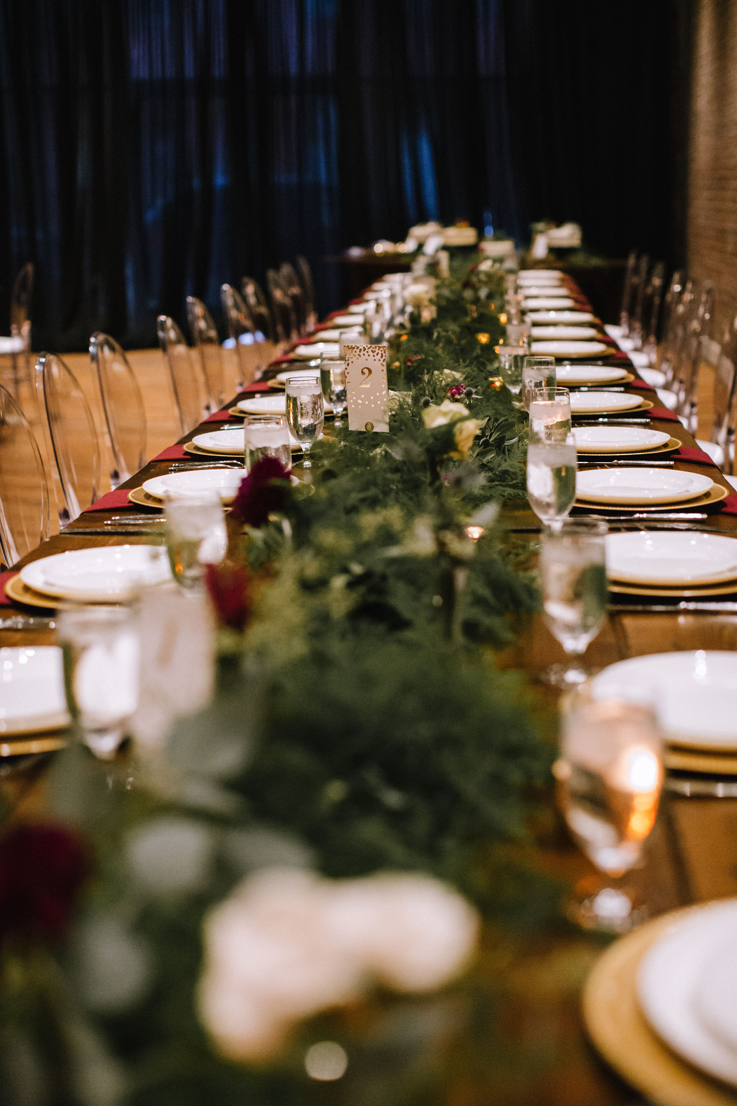 Wedding table decor with greenery and candles for Pittsburgh wedding at Studio Slate planned by Exhale Events. Find more wedding inspiration at exhale-events.com!